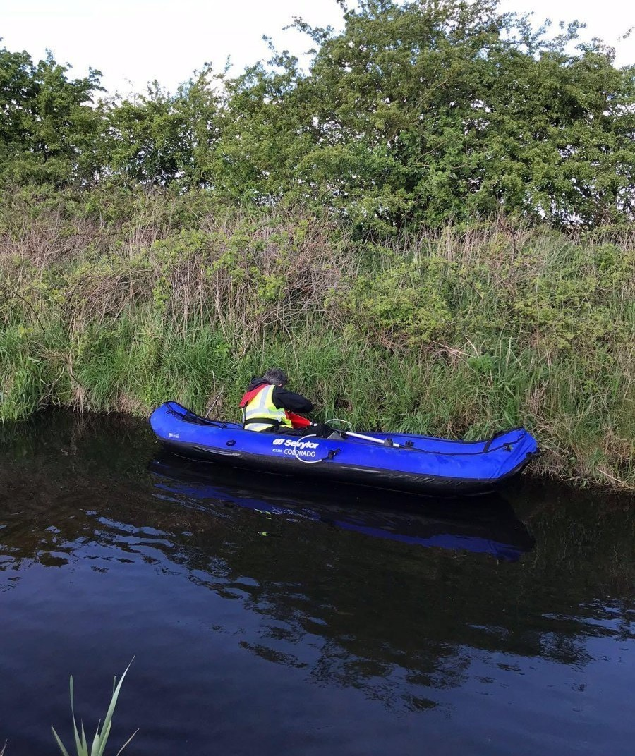Undertaking a water vole survey by kayak (photo by Amy Tose)