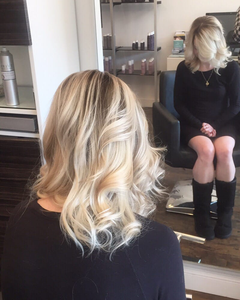 Styled blonde in salon chair