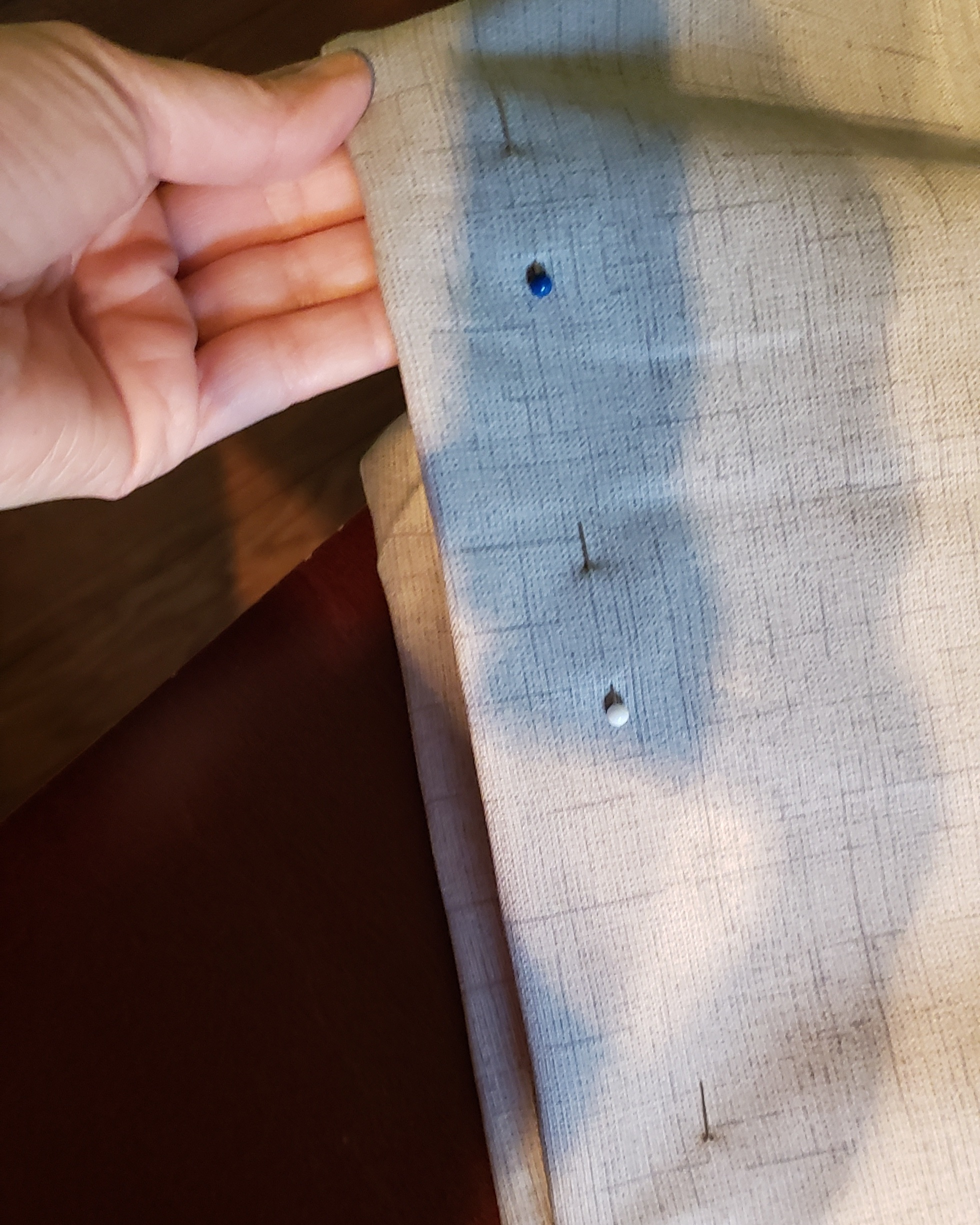 - I pinned down the fabric so that it wouldn't shift when I would soon pin the zipper to the inside.