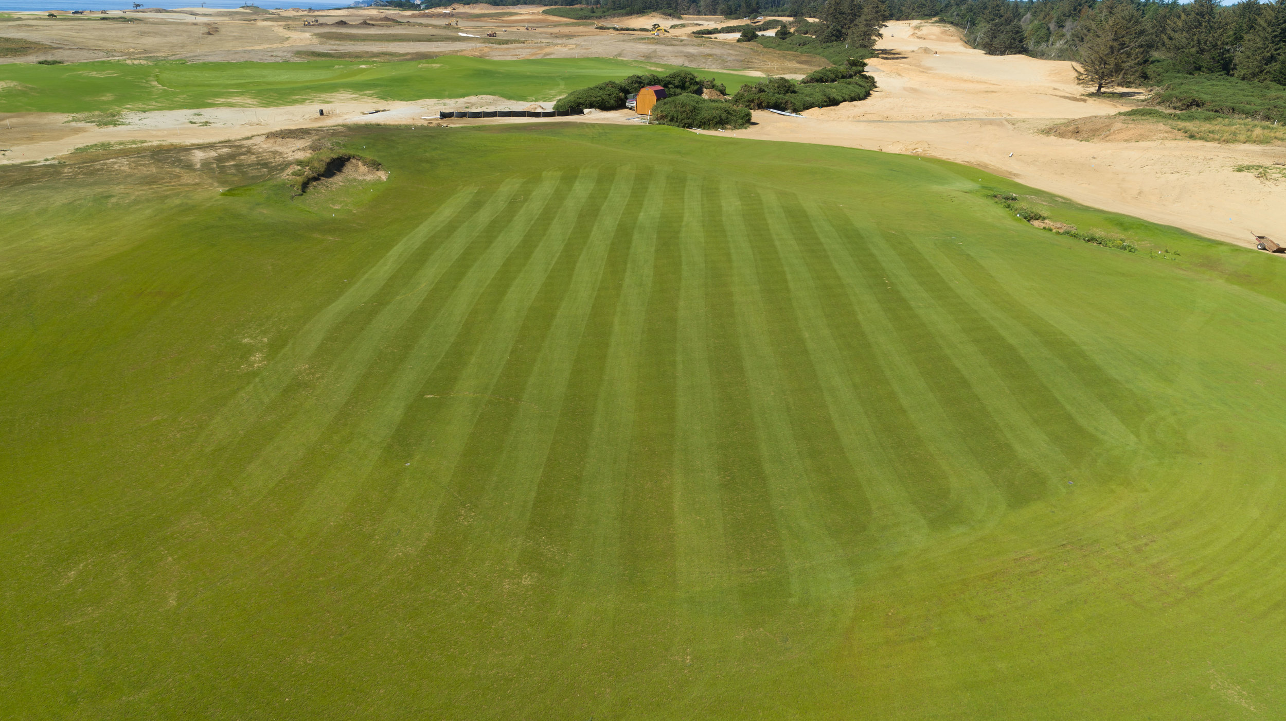 Playing directly north into the prevailing summer breeze, the 10th hole is a short Par-4 with teeth that finishes up in the central section of the course. Also, as stated above it will be located adjacent to the 4th and 14th greens as well as the 5th, 11th and 15th tees.