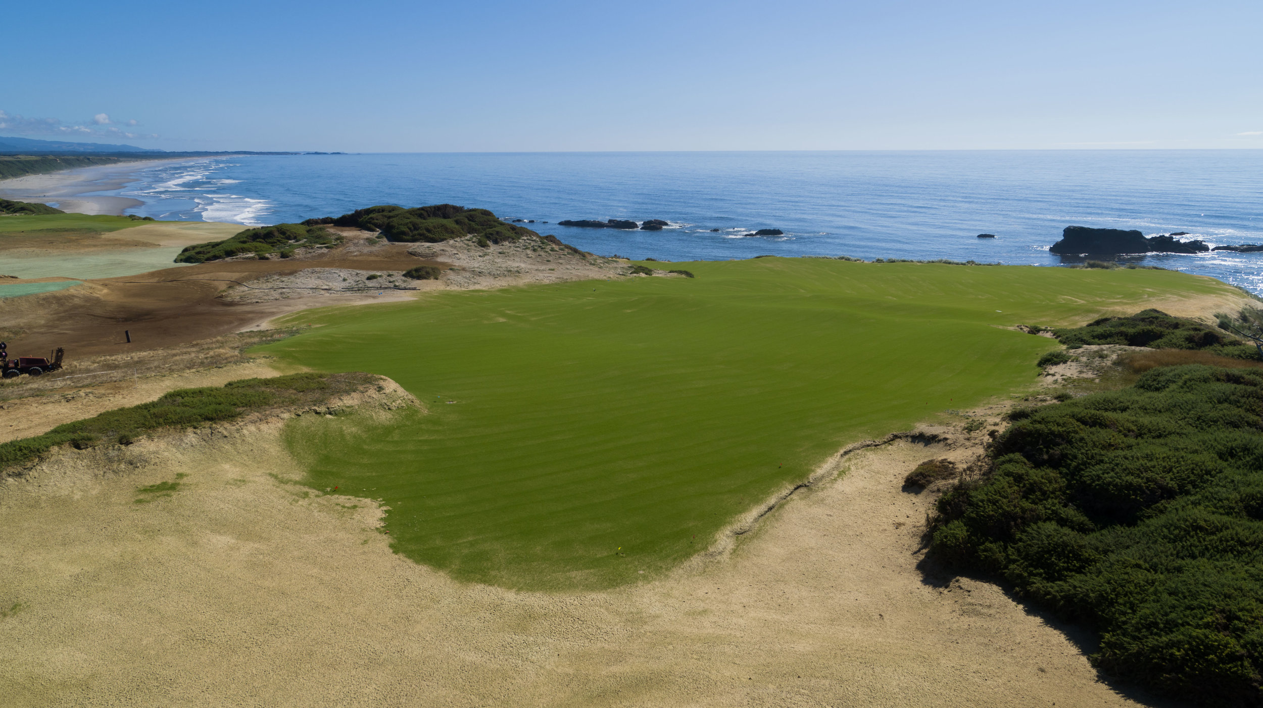The first of two approaches toward Five Mile Point, Sheep Ranch No. 3, is the first Par-3 on the front nine, providing an early glimpse of the double green. The prevailing summer wind will be coming off your right shoulder from the north.