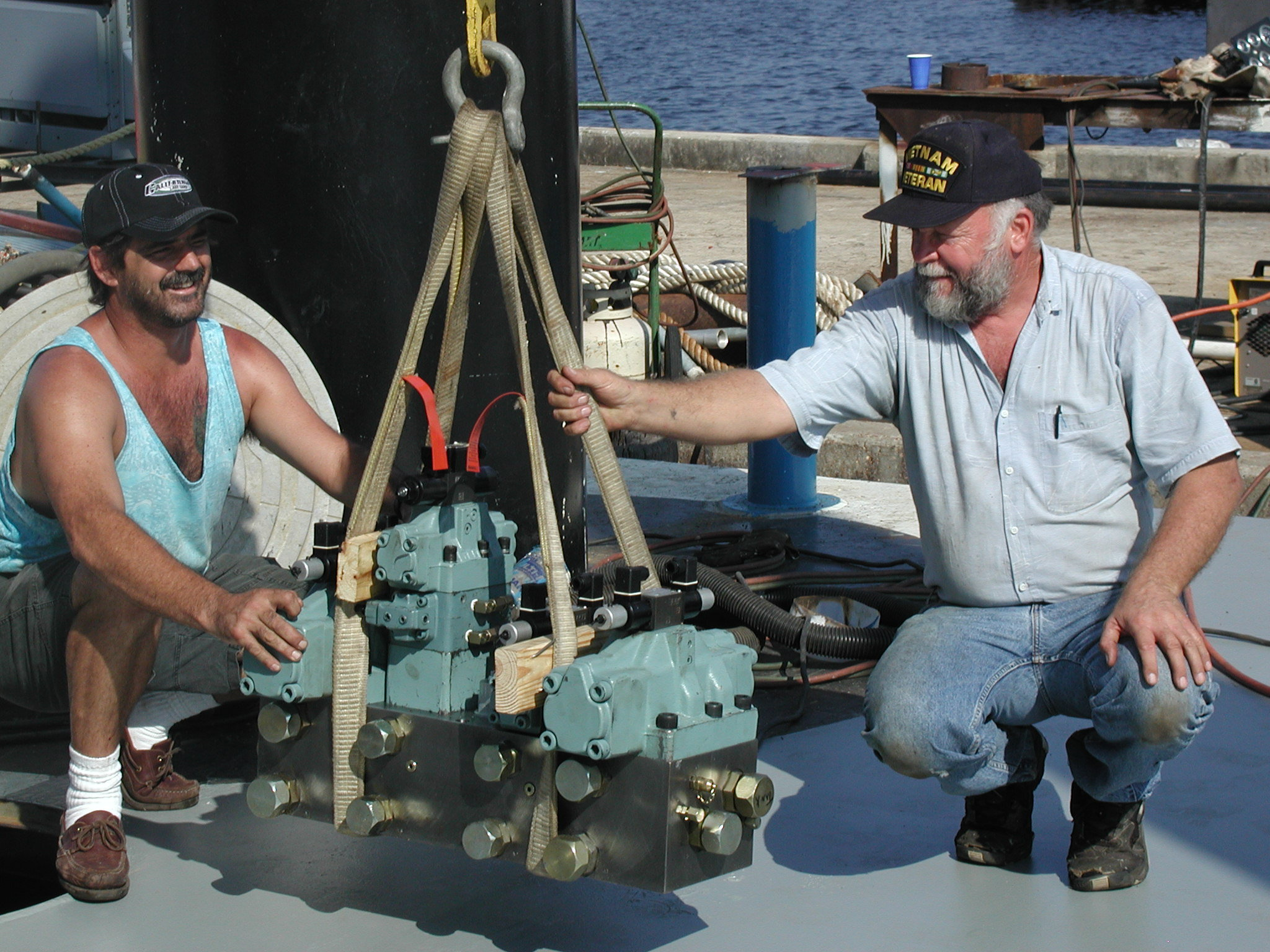 Doug and Jay with control valve.jpg