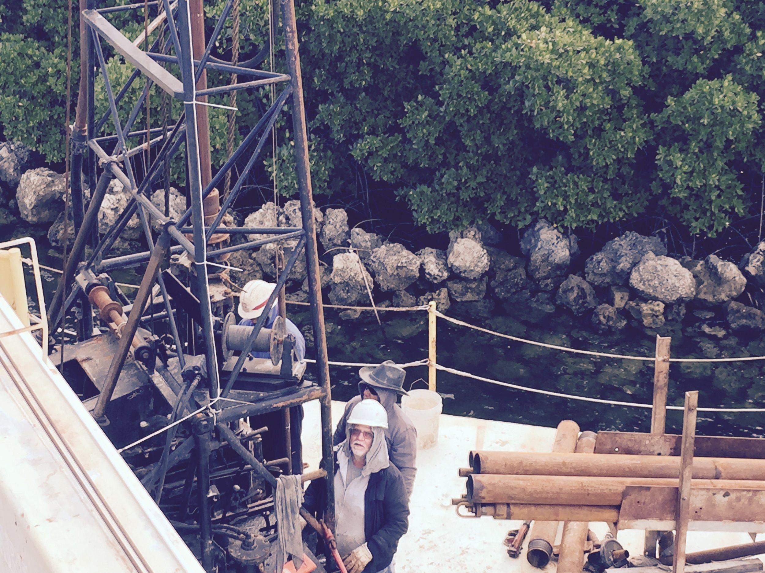 drill crew against rocks.jpg