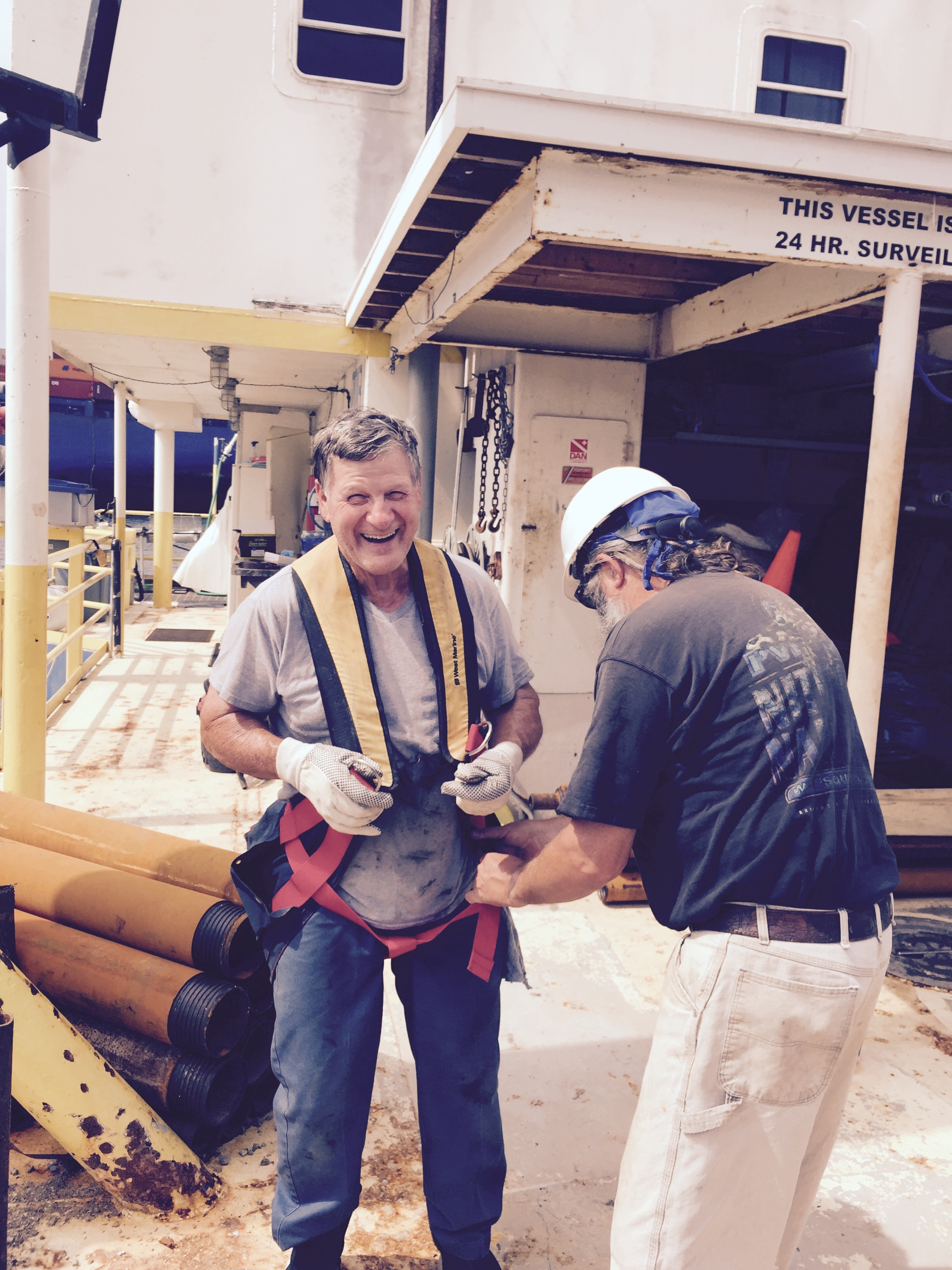 Keith helping Rene in to lifting harness.jpg