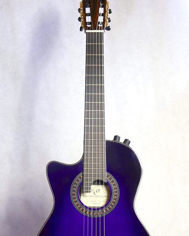 The newest addition to the #kozmokings family.  This #purple beauty was created and built by the maestro and master #luthier @mario_oretea at MCO guitars.  #songwriter #guitars #lefthanded #southpaw #artwork #lefthandedguitar #gypsy #flamenco #