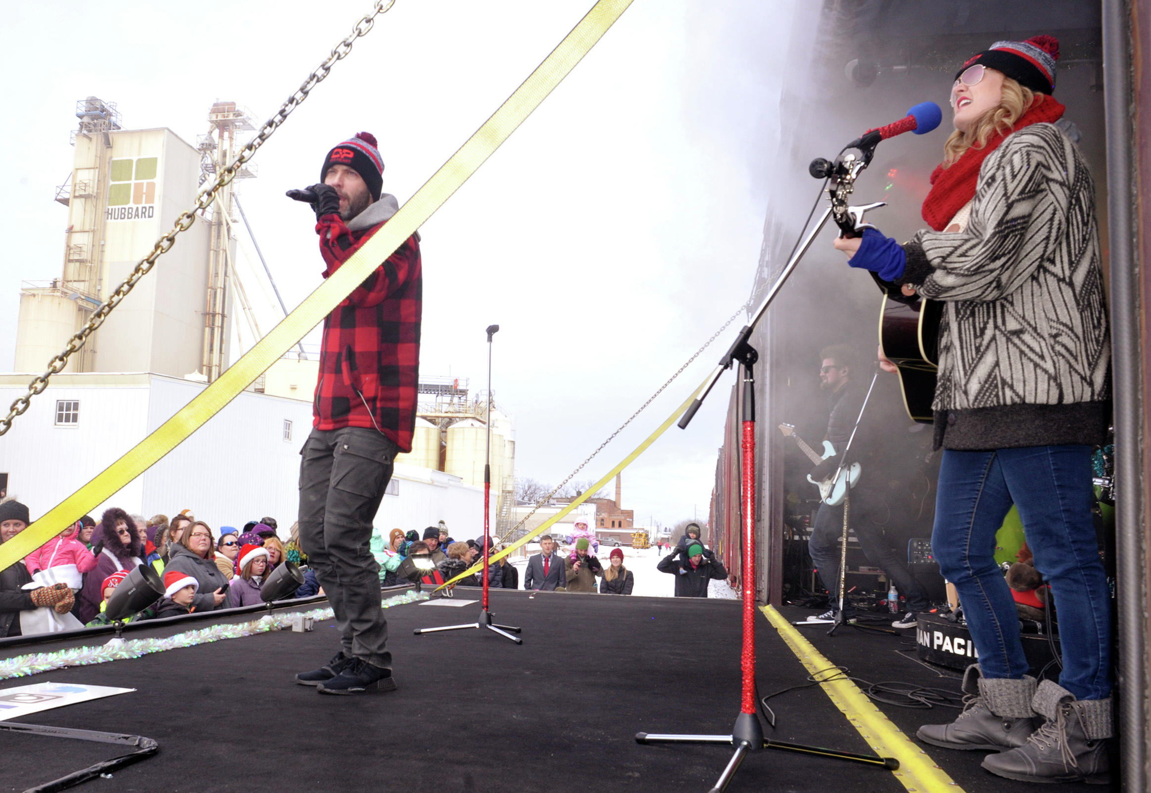 Dallas Smith, Kelly Prescott and the rest of the band perform on the Holiday Train for the audience at the Eighth Avenue crossing in Alexandria in December 2017. The Holiday Train has been running for nearly two decades as a fundraiser for supporting food banks. (Lowell Anderson / Echo Press)