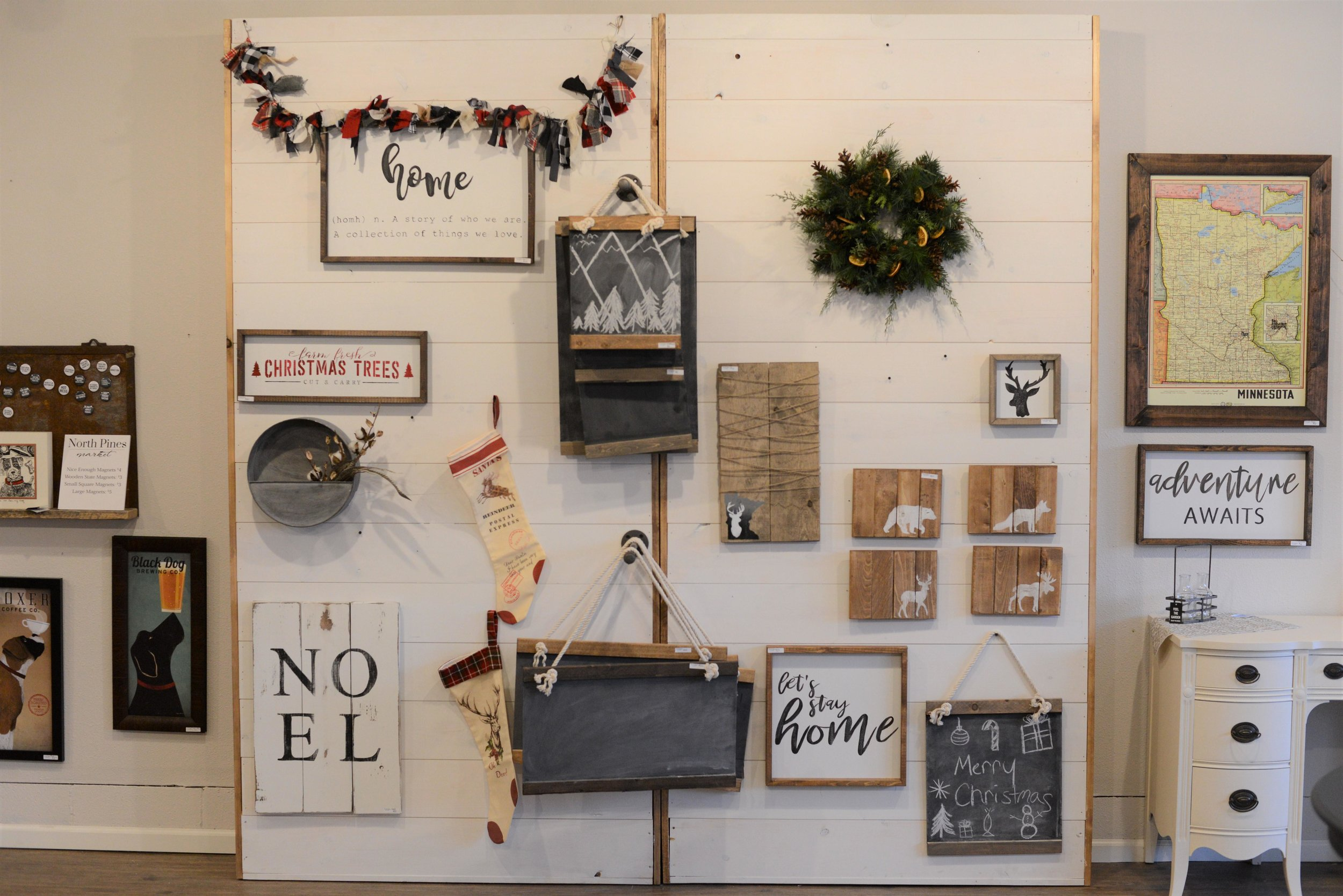 North Pines Market offers locally sourced gifts, custom furniture pieces and workshops making the barn signs pictured here. (Carter Jones / Perham Focus)