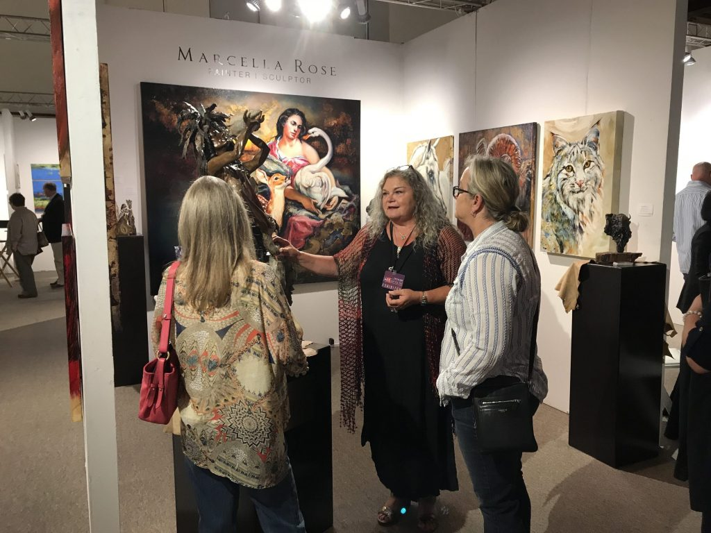 Local artist Marcella Rose, greeting visitors at the internationally acclaimed Santa Fe art show last summer.