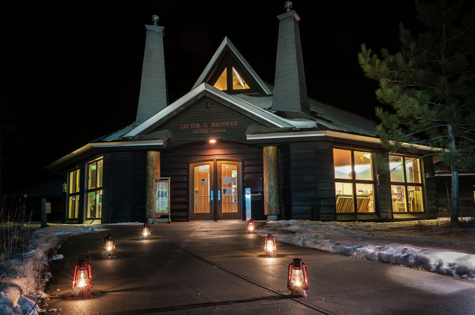 The path to the Jacob V. Brower Visitor Center will be lit by kerosene lanterns during the park's annual Lantern Lit Ski & Snowshoe event, which gets underway at 5 p.m. next Saturday, Jan. 12. (Minnesota DNR photo)