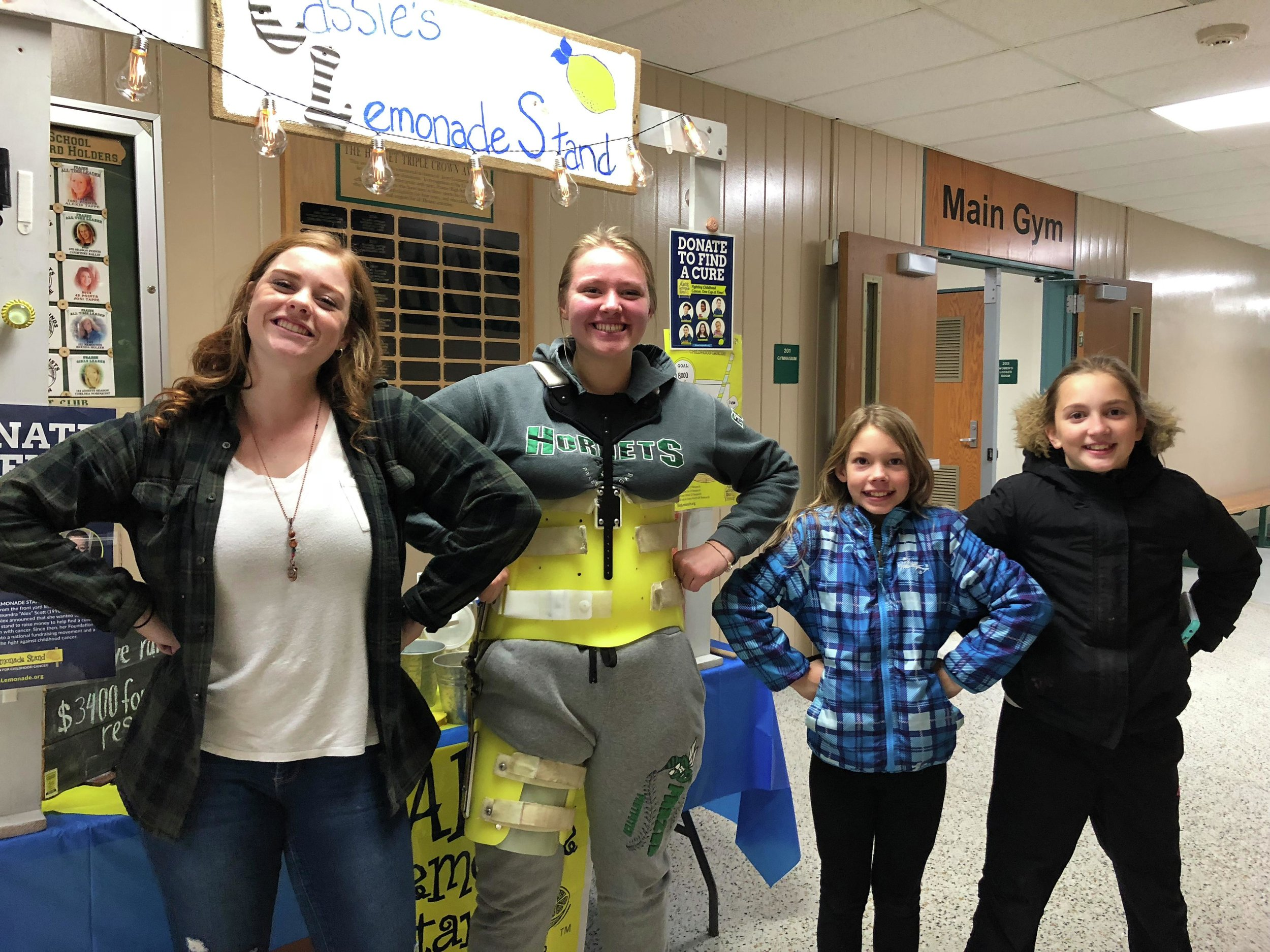 Cassidy Shipman, far left, with friend Annie Bachmann and some younger supporters of 'Cassie's Lemonade Stand' at a recent high school sports event. (Submitted photo)