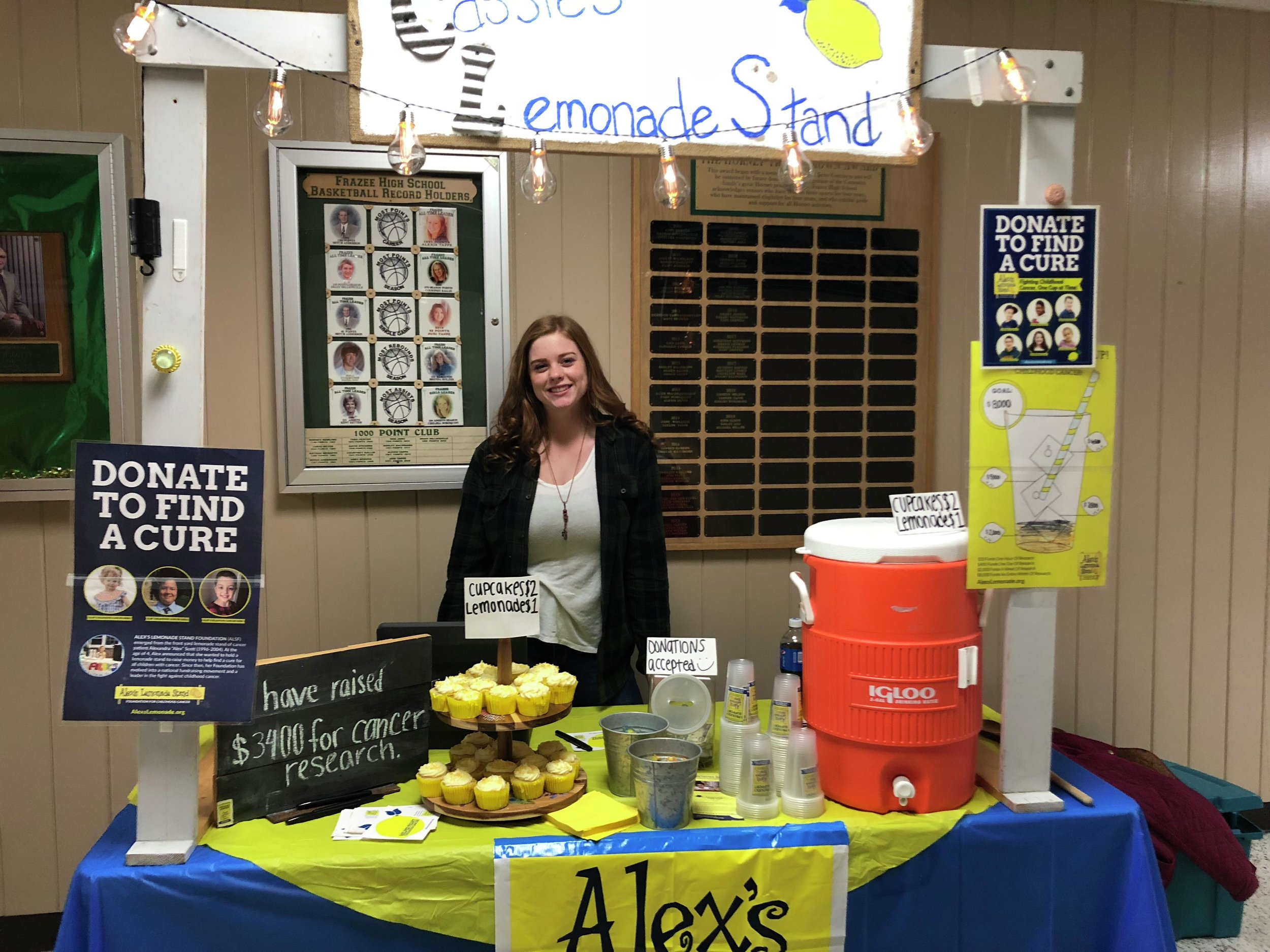 Cassidy Shipman mans her lemonade stand and helps raise awareness for the cause of fighting childhood cancers during a recent Frazee High School sporting event. Since she got involved with the Alex's Lemonade Stand Foundation, Cassie has raised $3,400 for the cause. (Submitted photo)