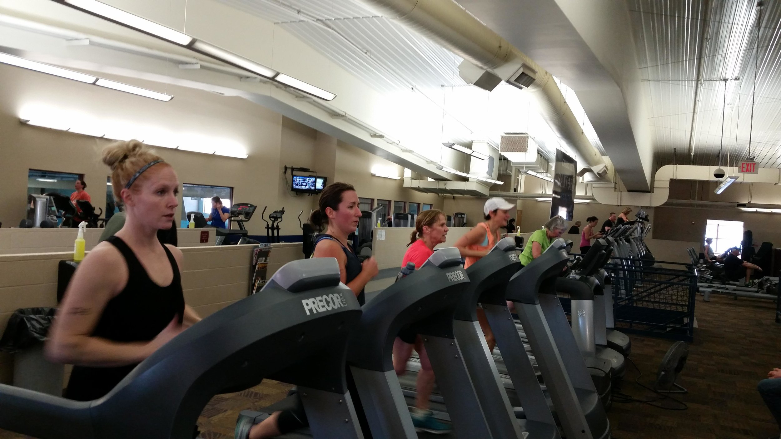 Competitors at the DLCCC's Indoor Triathlon push themselves to get in as many miles as possible during their 20-minute run on the treadmill, one of three phases that they must complete during the event. This year's triathlon is set for Saturday, Feb. 2. (Submitted photo)