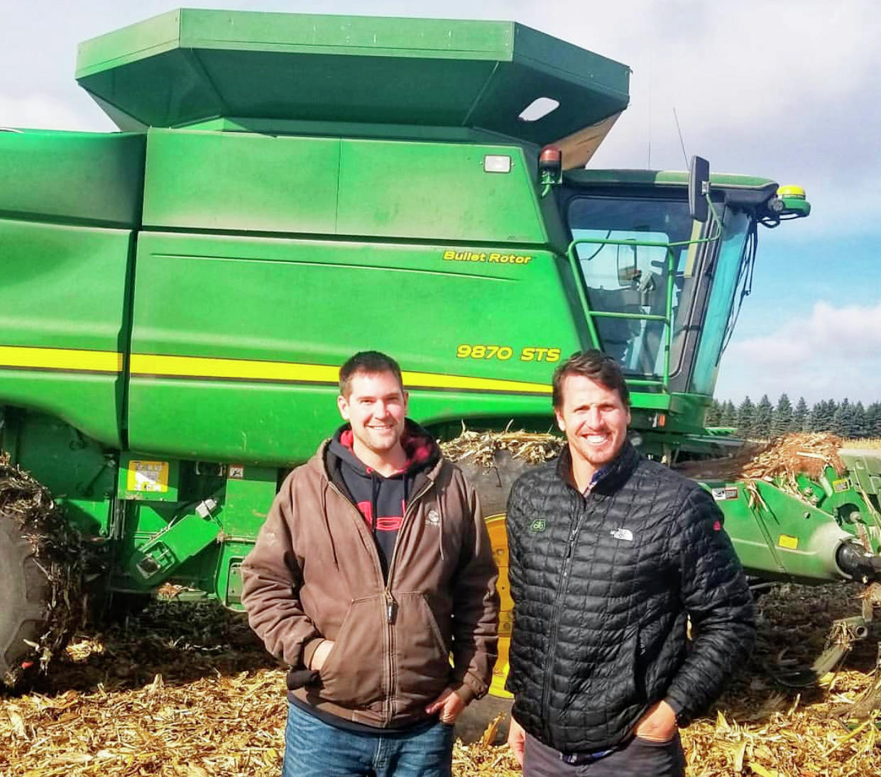 Zach Johnson (left) and former Minnesota Viking Chad Greenway (right) pose in front of a tractor in the middle of shooting a video for Johnson's YouTube channel. (Contributed)