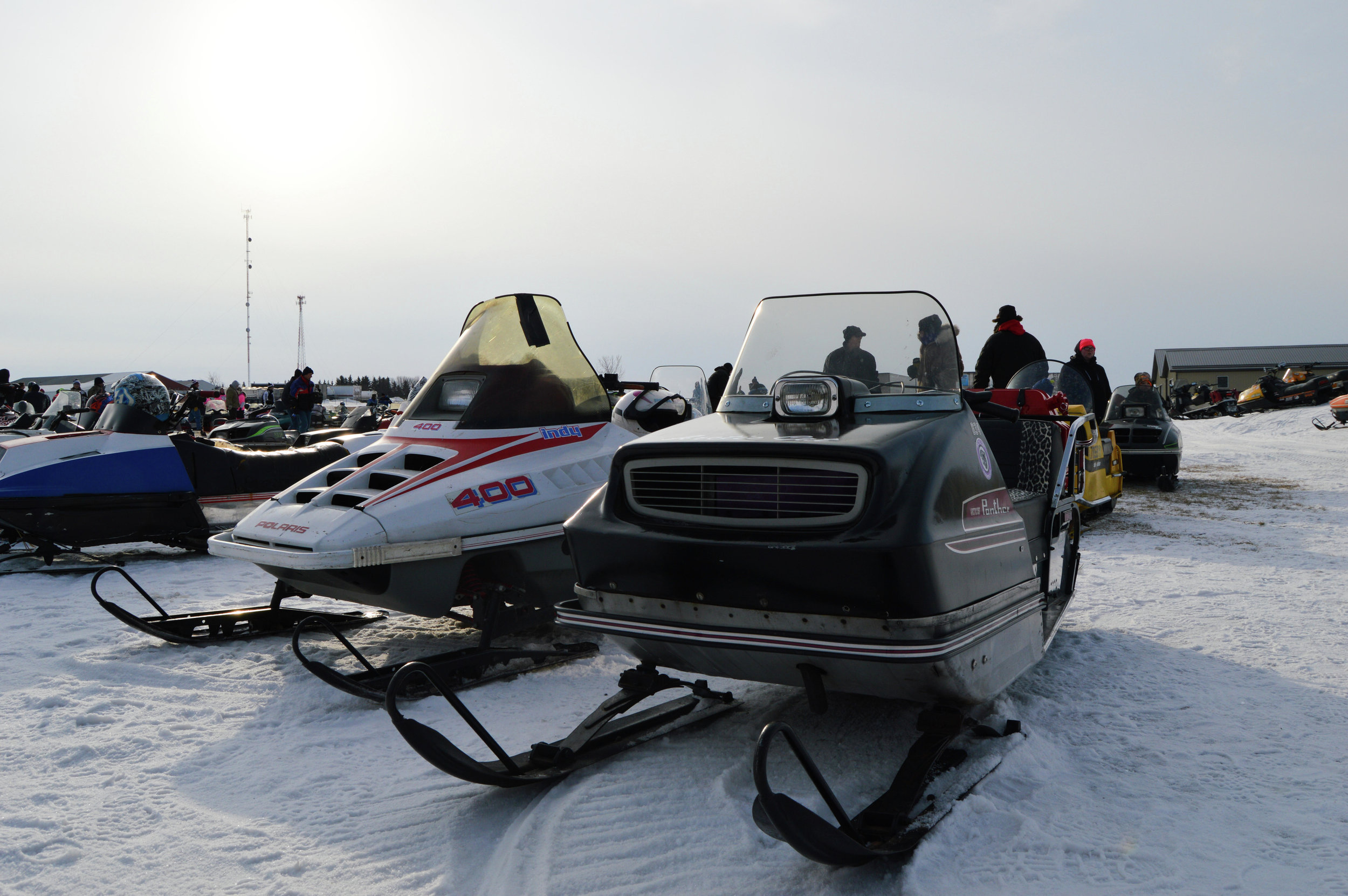Waiting to head out on the 2017 Old Timers Run, riders and sleds mingled outside the Lake Park Liquor Store during the early hours of the morning. (Tribune file photo)