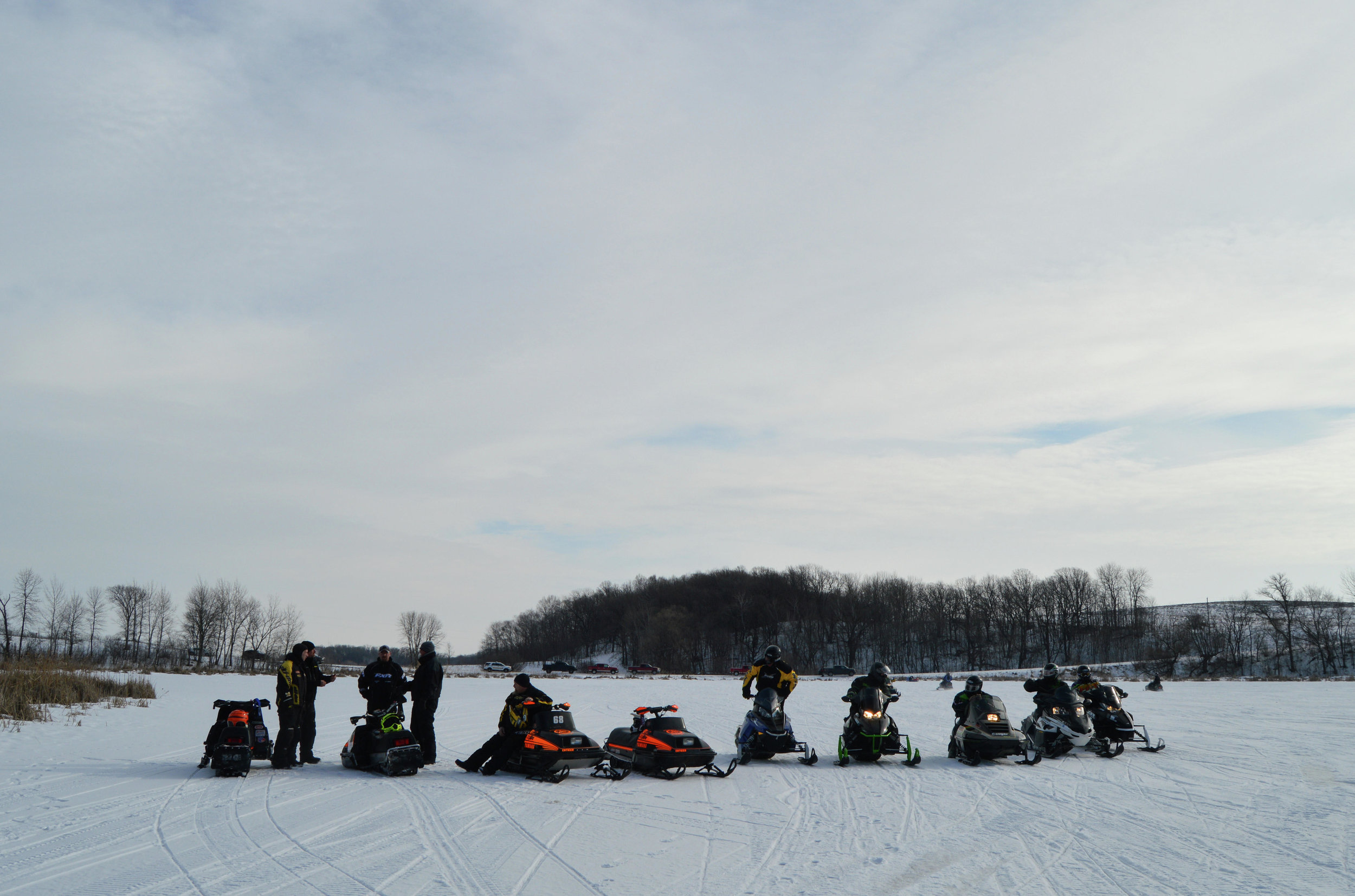 Lined up and ready to ride, the snowmobilers waited their turn to ride up Nylander Hill during the 2017 Old timer's Run. (Tribune file photo)