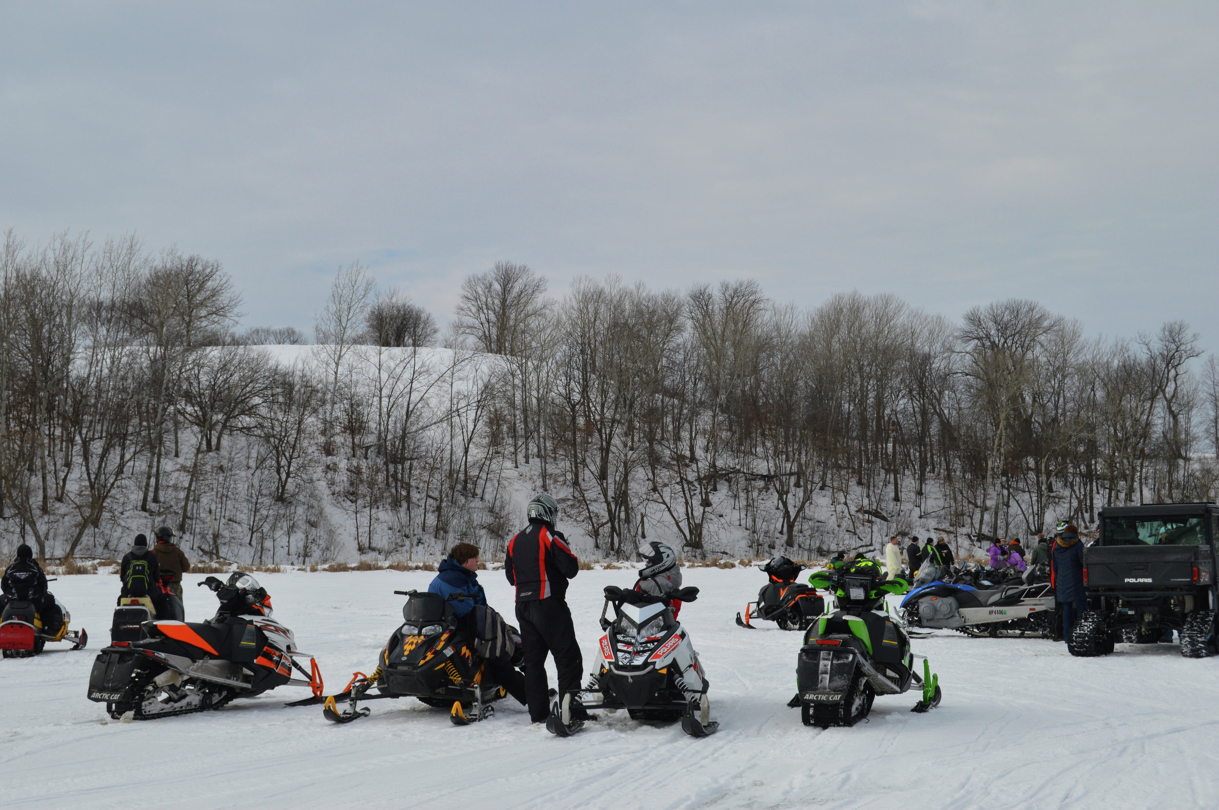 Looking up at the steep slope of Nylander Hill, the riders at the 2017 Old Timer's Run dared one anther to test their skills and their sleds on the run to the top. Event organizer Bill Livdahl says one of the main challenges is keeping the older sleds running during the 39-mile run. (Tribune file photo)