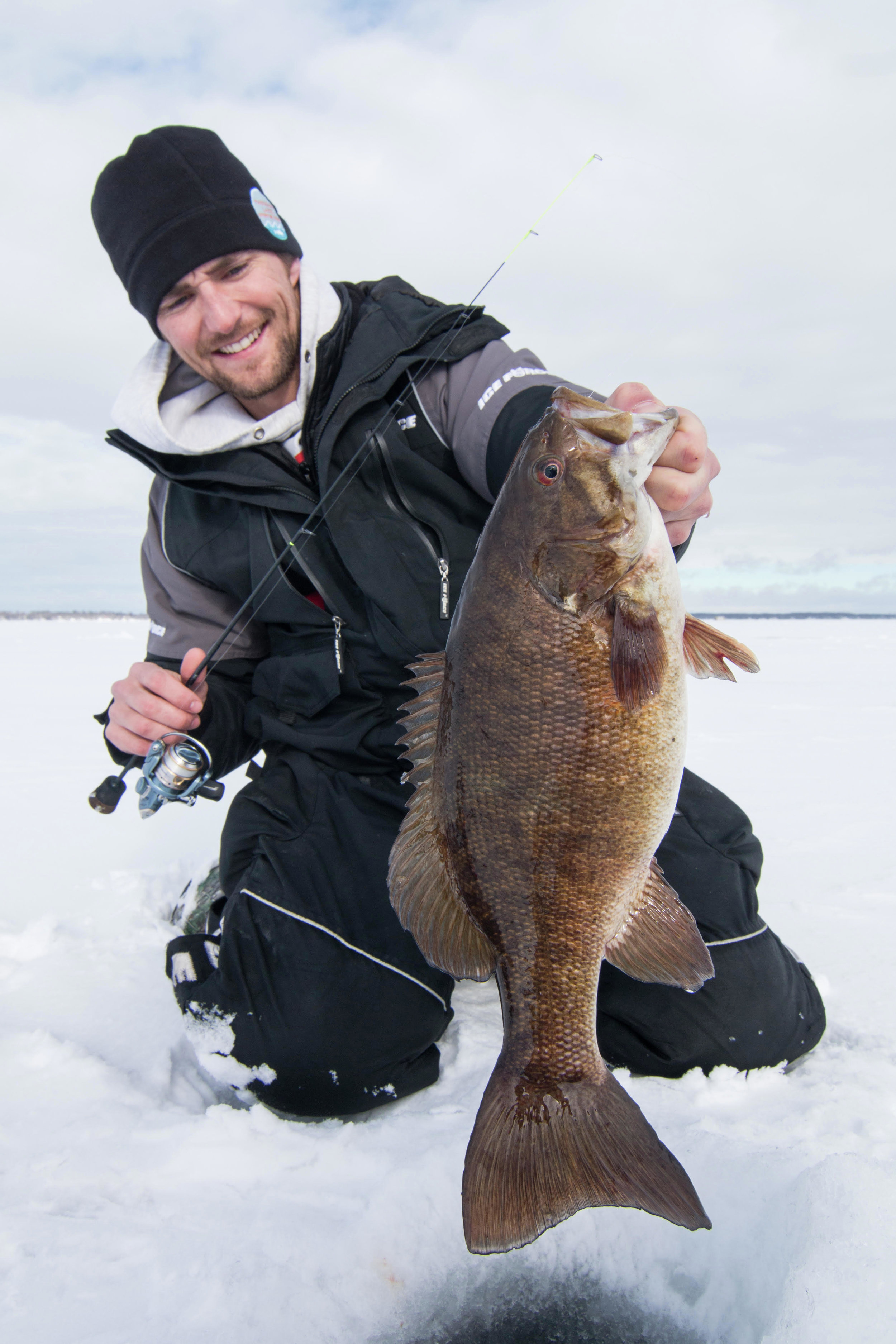 Andy Walls with a trophy smallmouth caught on a light panfish rig. Finesse presentations often account for the biggest fish caught during winter. Submitted photo / Christian Hoffman
