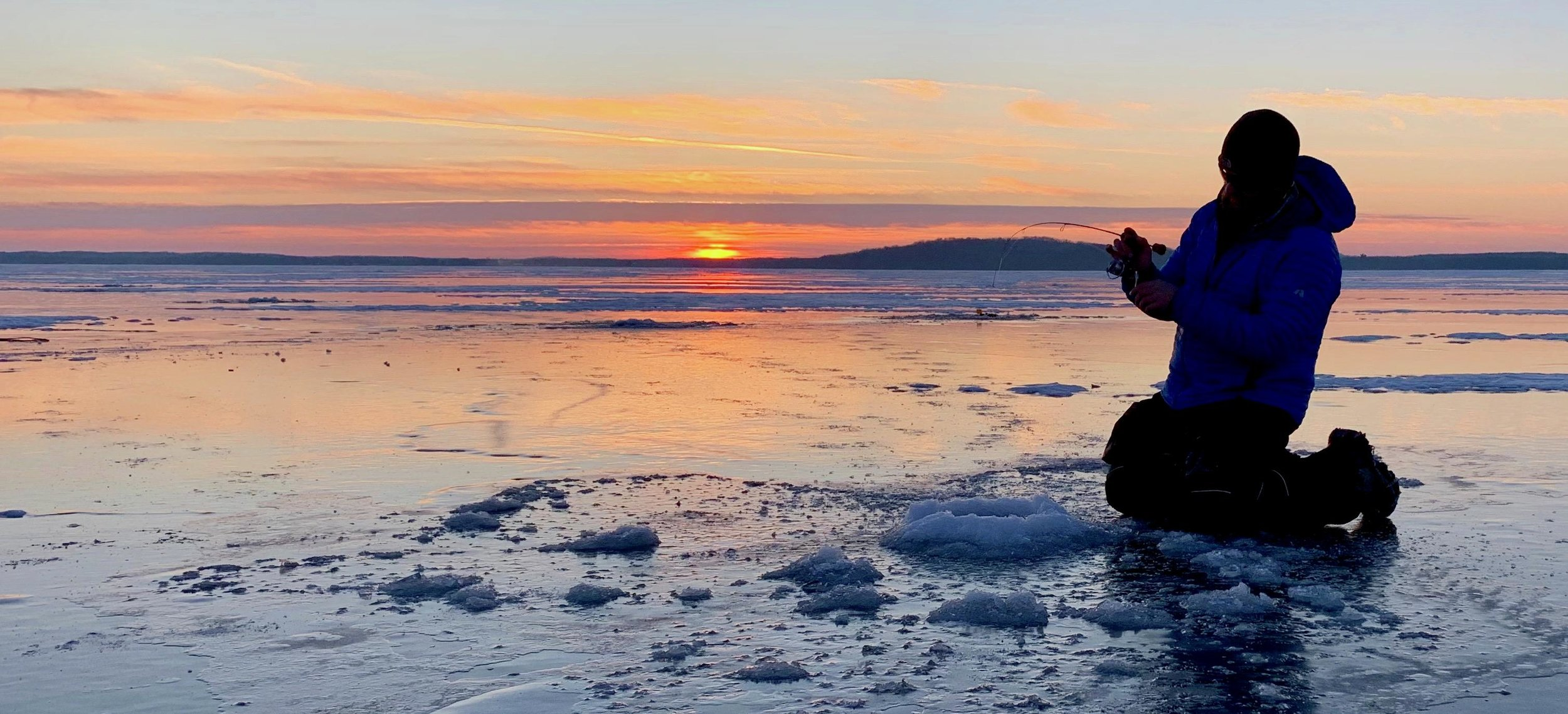 Christian Hoffman sets the hook on a big smallmouth bass just before sunrise on Mille Lacs Lake. Submitted photo / Christian Hoffman