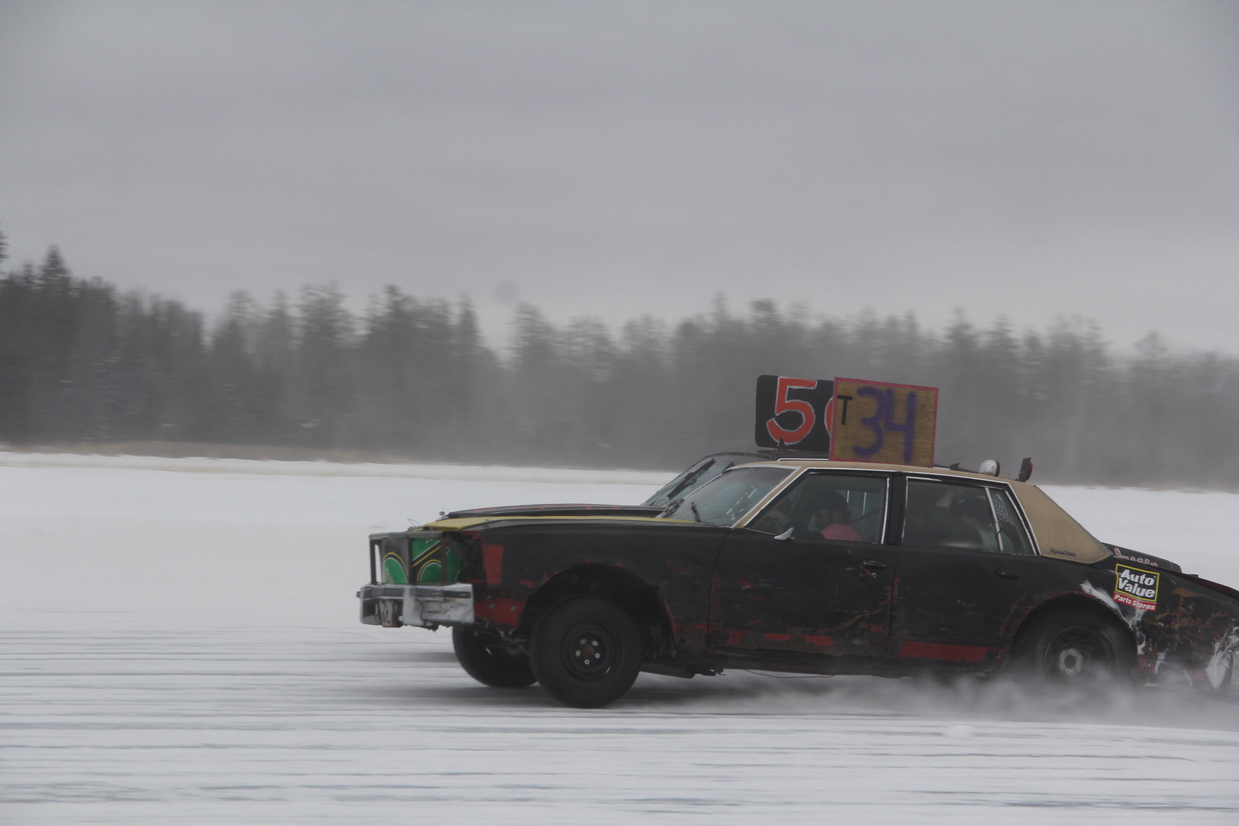 In the second set feature of the B class during Sunday's Garfield Lake ice races, it was a photo finish between Chris Roller (No. 34) and Reid Watson (No. 50). Roller was declared the winner. (Dennis Peterson | Special to the Pioneer)