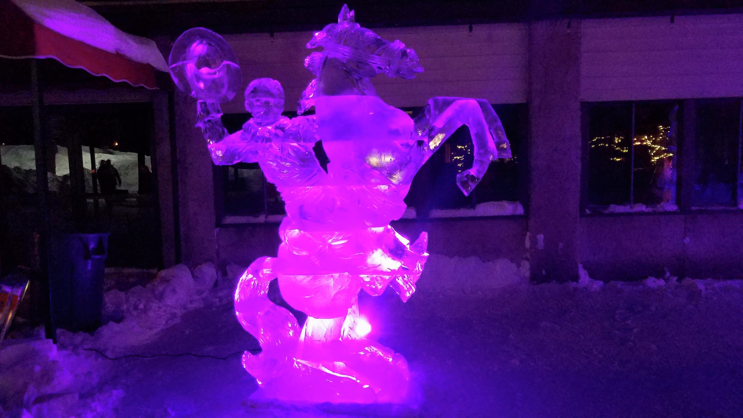 """The completed """"Bucking Cowboy"""" sculpture was quite a sight later that evening, when the colors of the LED lights really showed it off. (Vicki Gerdes / Tribune)"""
