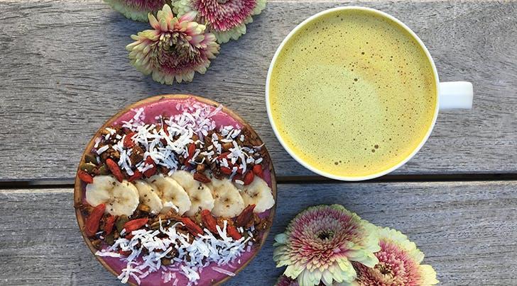 turmeric-latte-next-to-a-smoothie-bowl.jpg