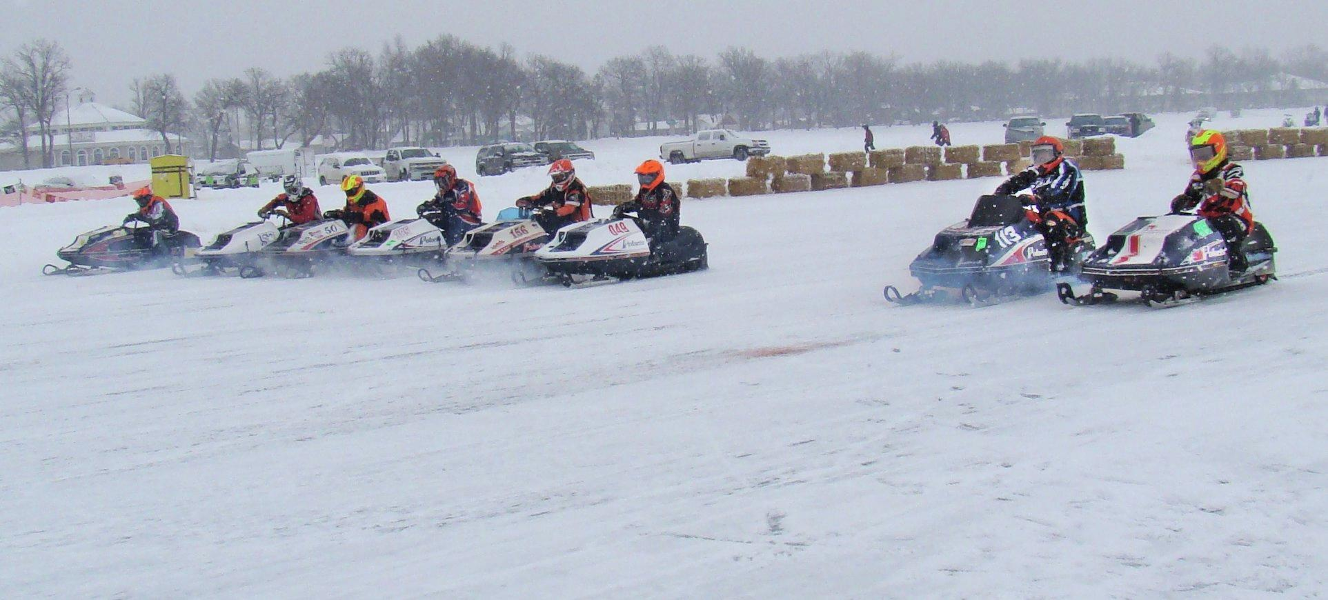 Ready, set... racers lined up in their vintage sleds for the start of a heat during last year's Ice Harvest 440 in Detroit Lakes. Organizers estimated there were between 600-650 people in attendance at the event. (Submitted Photo)