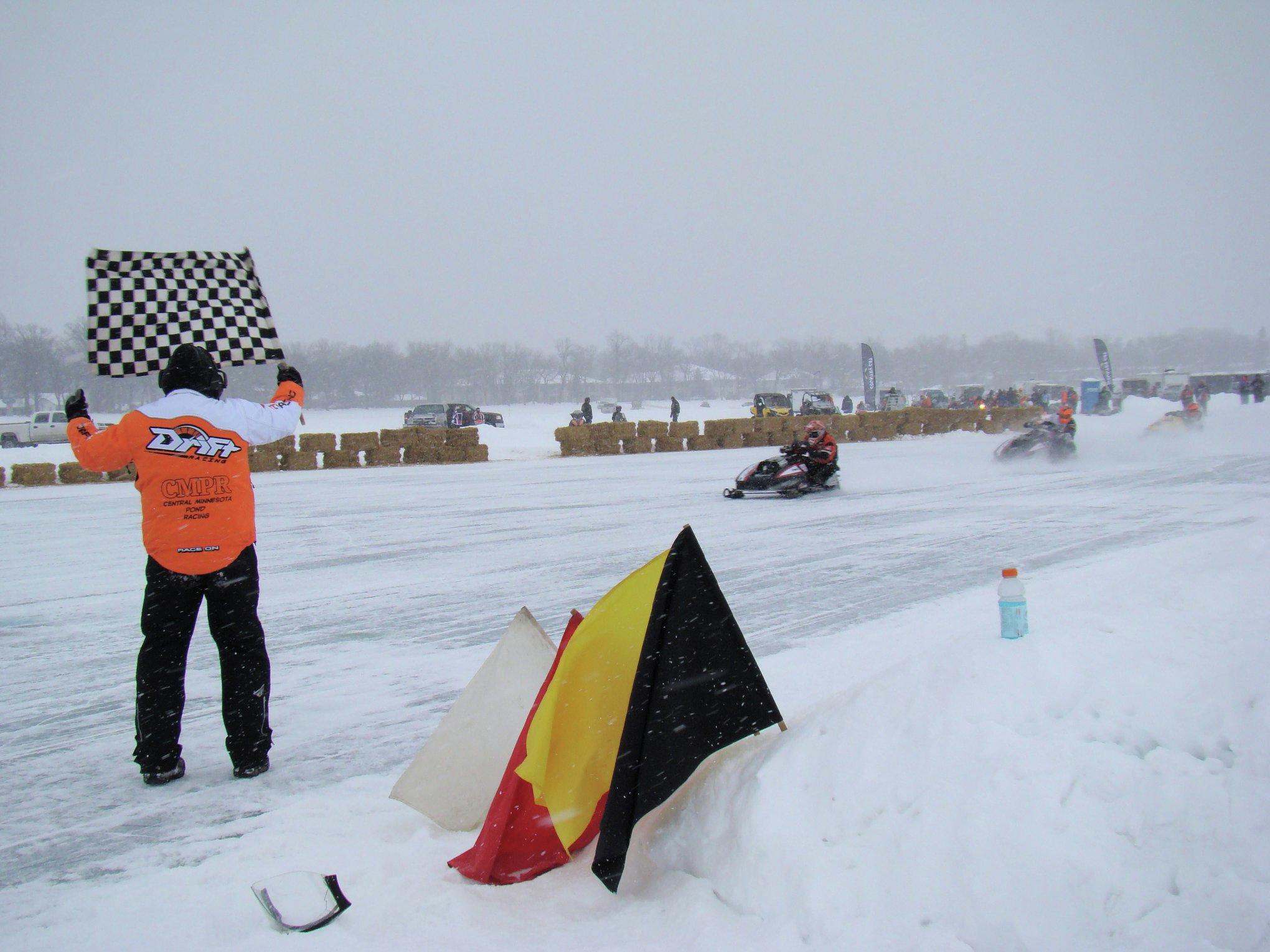 There was plenty of excitement at the inaugural Ice Harvest 440 in February 2018, as racers rounded the corner of the oval pond racing track on Little Detroit Lake. (Submitted Photo)