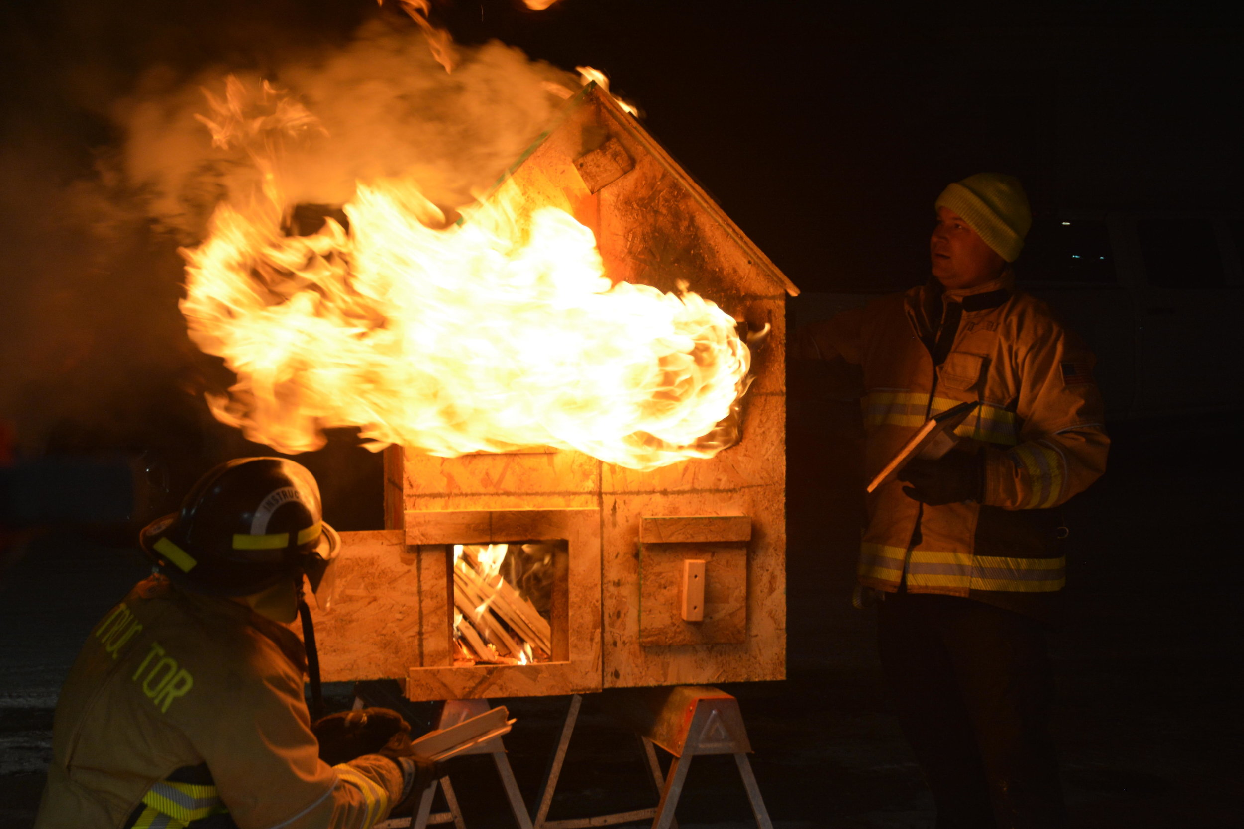 Eric Makowski-Budrow periodically closed off openings to the doll house to demonstrate how pressure changes affect a fire. Michael Denny/Wadena Pioneer Journal