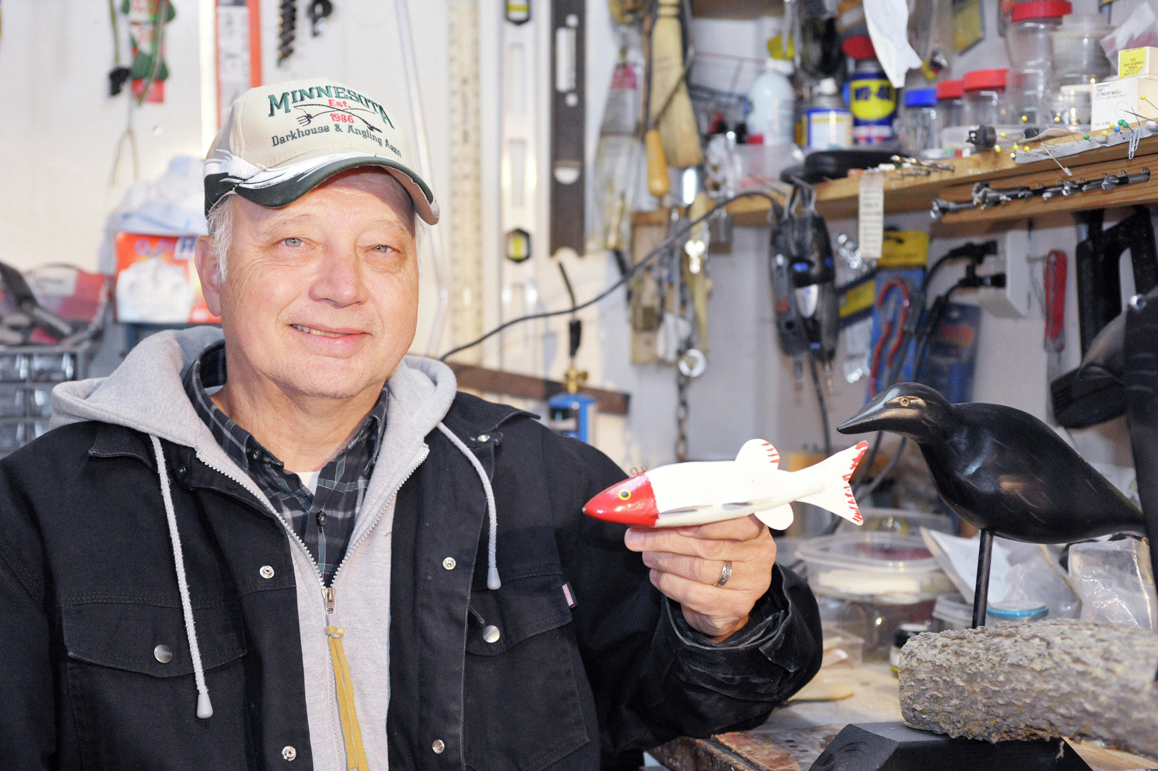 At his shop, Hedlund is surrounded by some of the tools he uses to carve his creations. (Lowell Anderson / Echo Press)