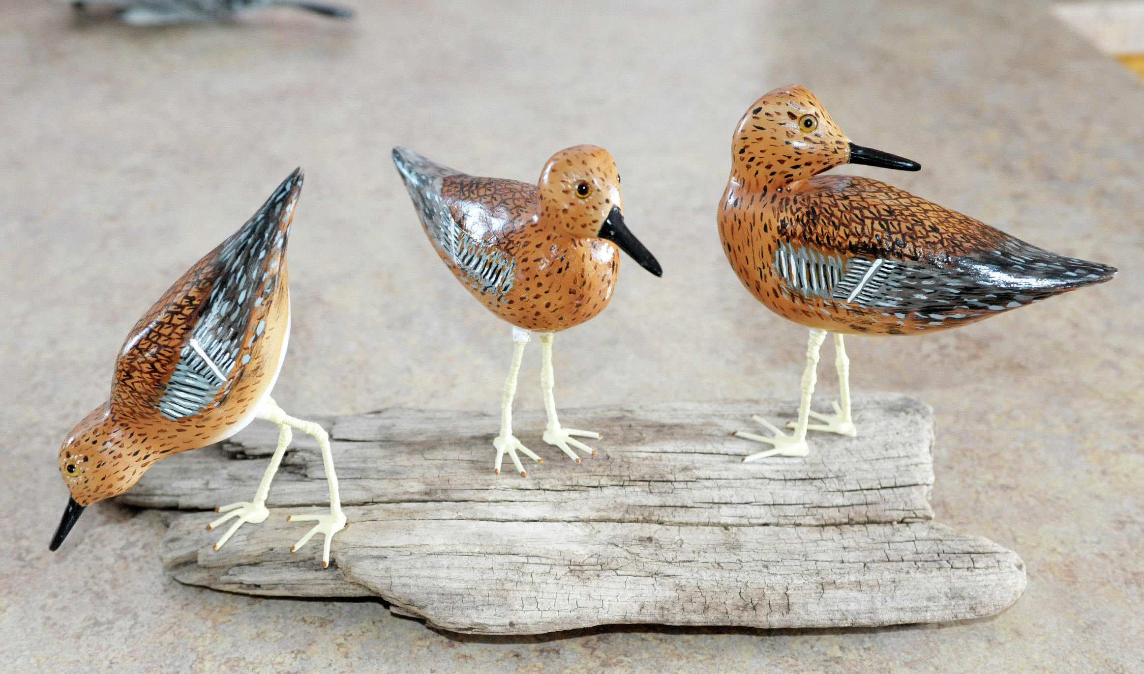In recent years, Hedlund has expanded his work to include more decorative carvings such as these birds. (Lowell Anderson / Echo Press)