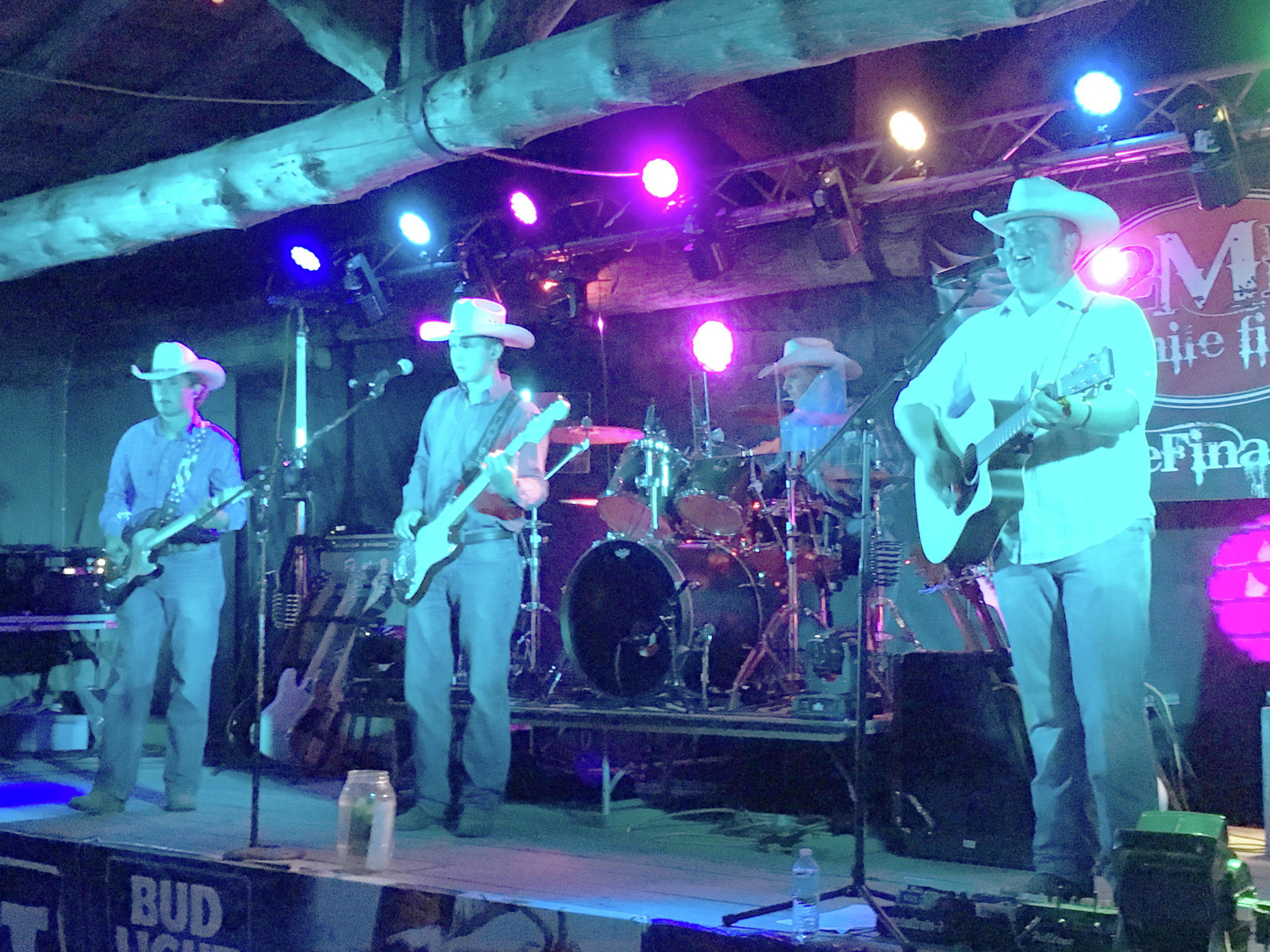 Tim, Dan, Derek and Jack cowboy up for their performance at the PBR Bullride and PRCA Rodeo in 2018. (Submitted photo)