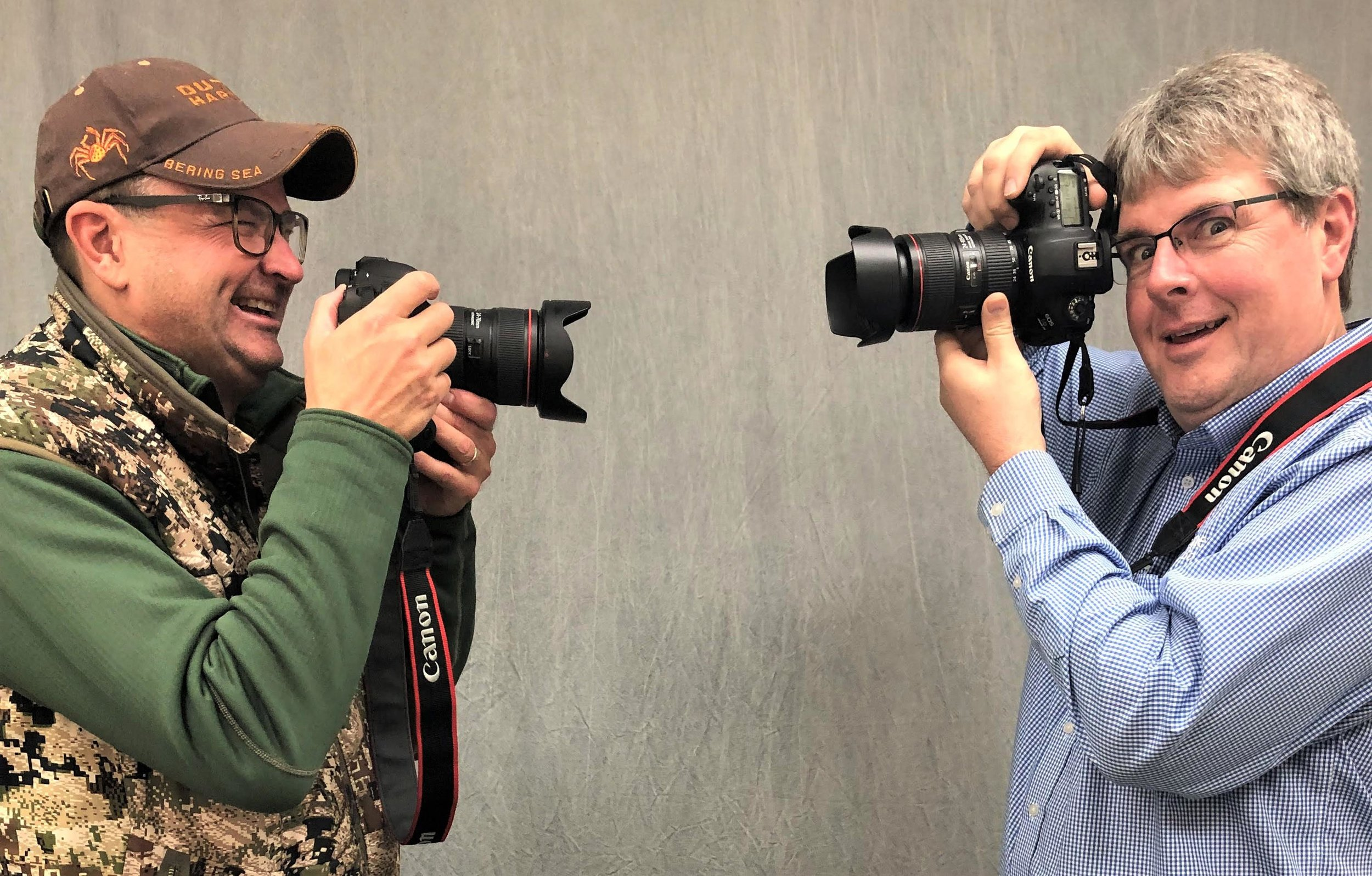 Longtime friends and amateur photographers Dave Baer, left, and Jim Sinclair goof around during a photo shoot at the Tribune in early March. (Paula Quam / Tribune)