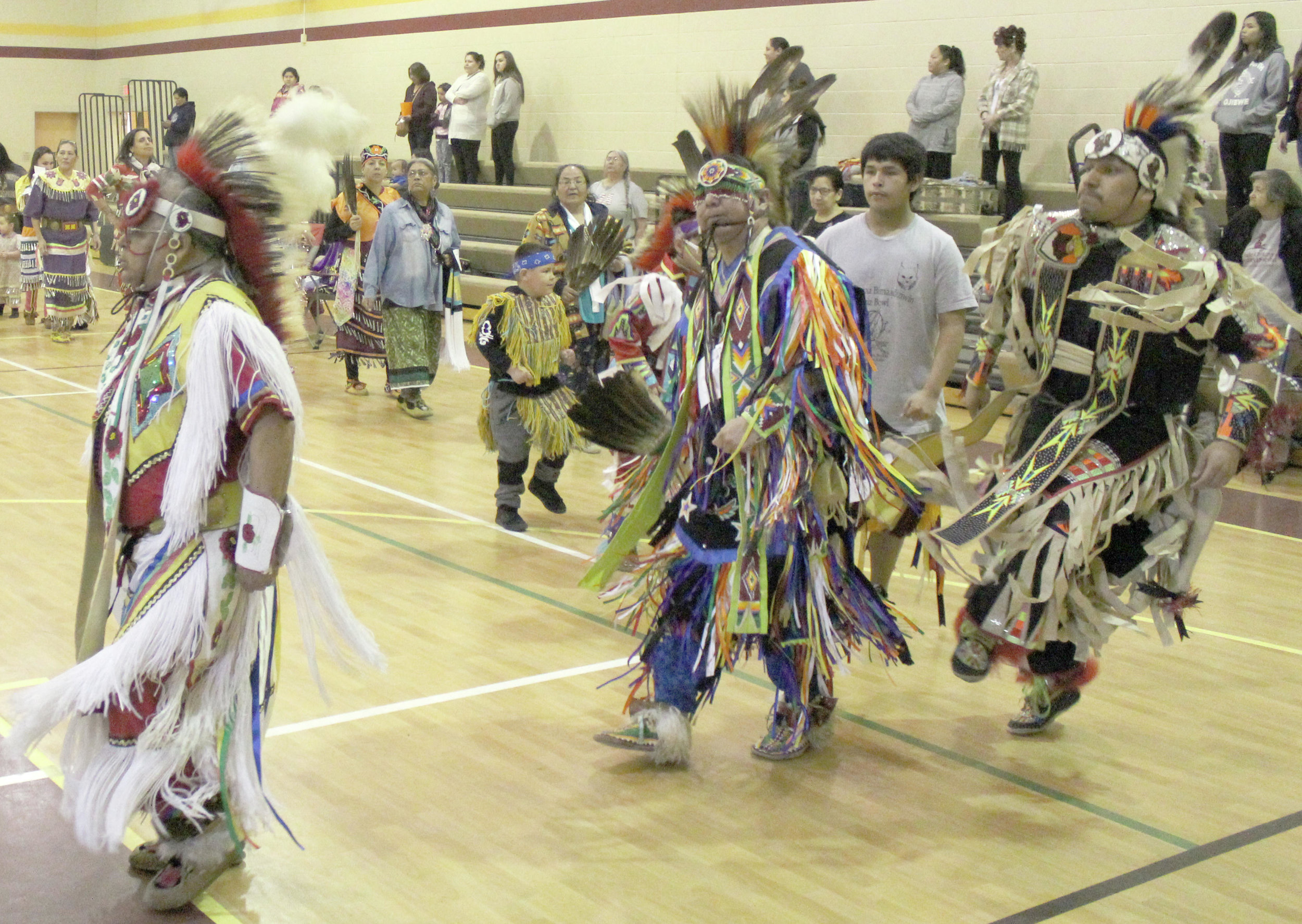 While some participants in the grand entry moved in sedate step, some danced up a sweat and kept the tassels of their ceremonial regalia in motion.