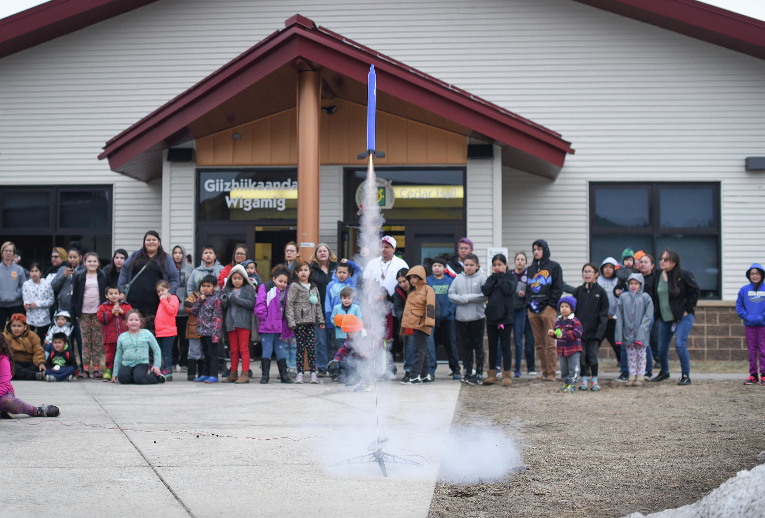 A crowd watches a rocket launch on Thursday at Leech Lake Tribal College's fourth annual Across the Universe event. (Jillian Gandsey | Bemidji Pioneer)