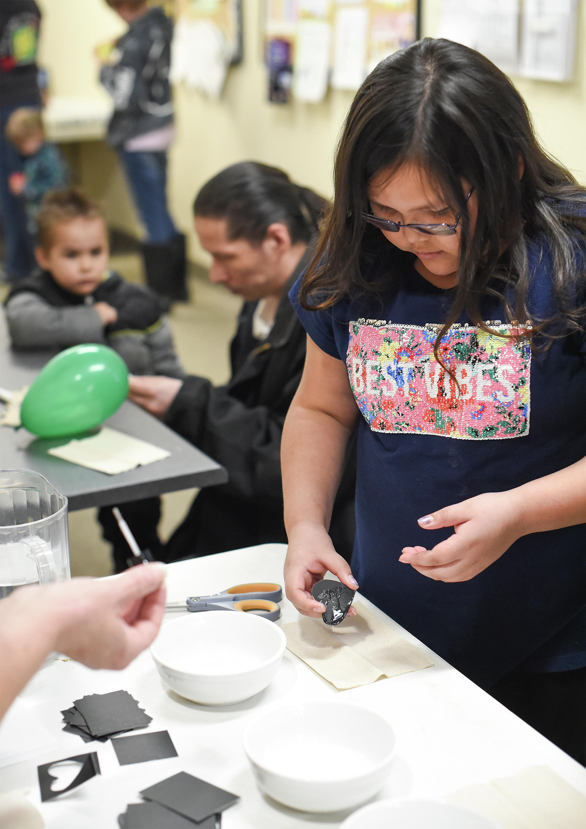 Larissa Eischens, 8, creates a thin-film light refraction on Thursday at Leech Lake Tribal College's fourth annual Across the Universe event. (Jillian Gandsey | Bemidji Pioneer)