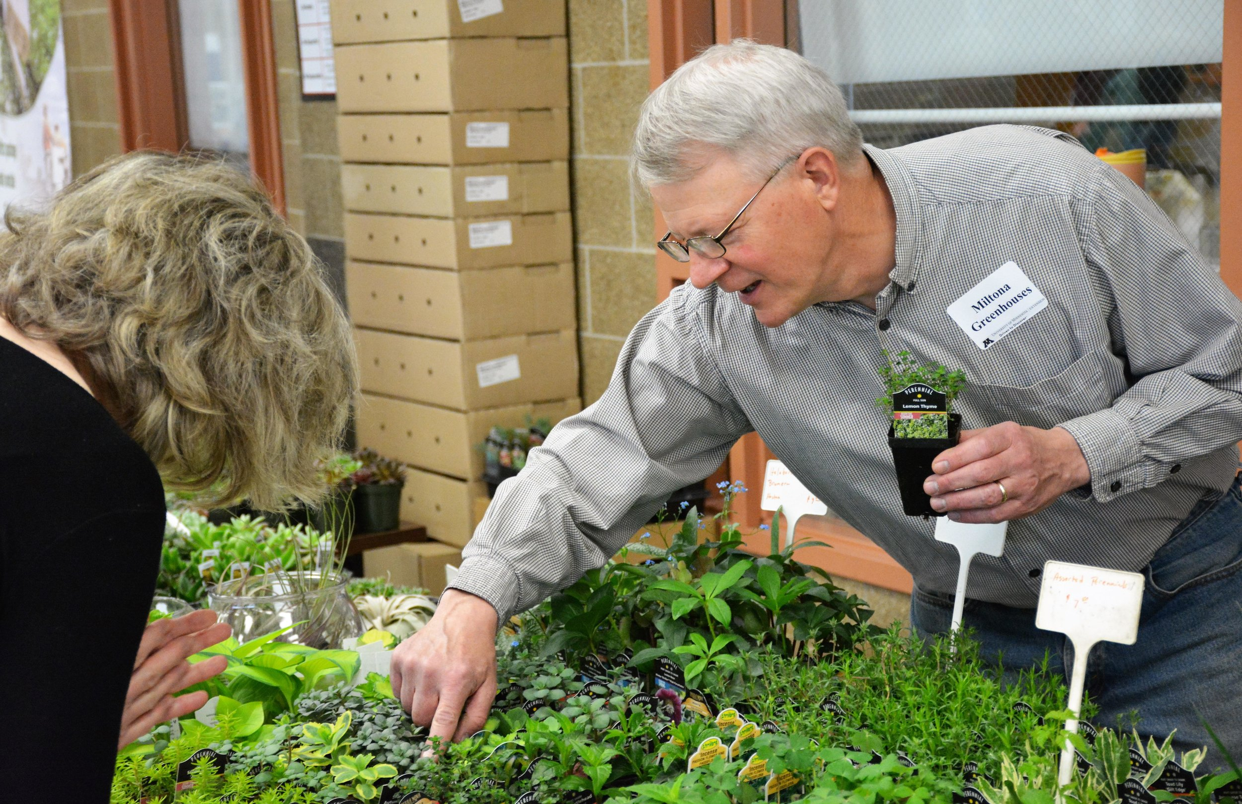 "David Vaske of Miltona Greenhouses answers a customer's question at the ""Let's Get Growing"" gardening workshop Saturday at Discovery Middle School. (Ross Evavold / Echo Press)"