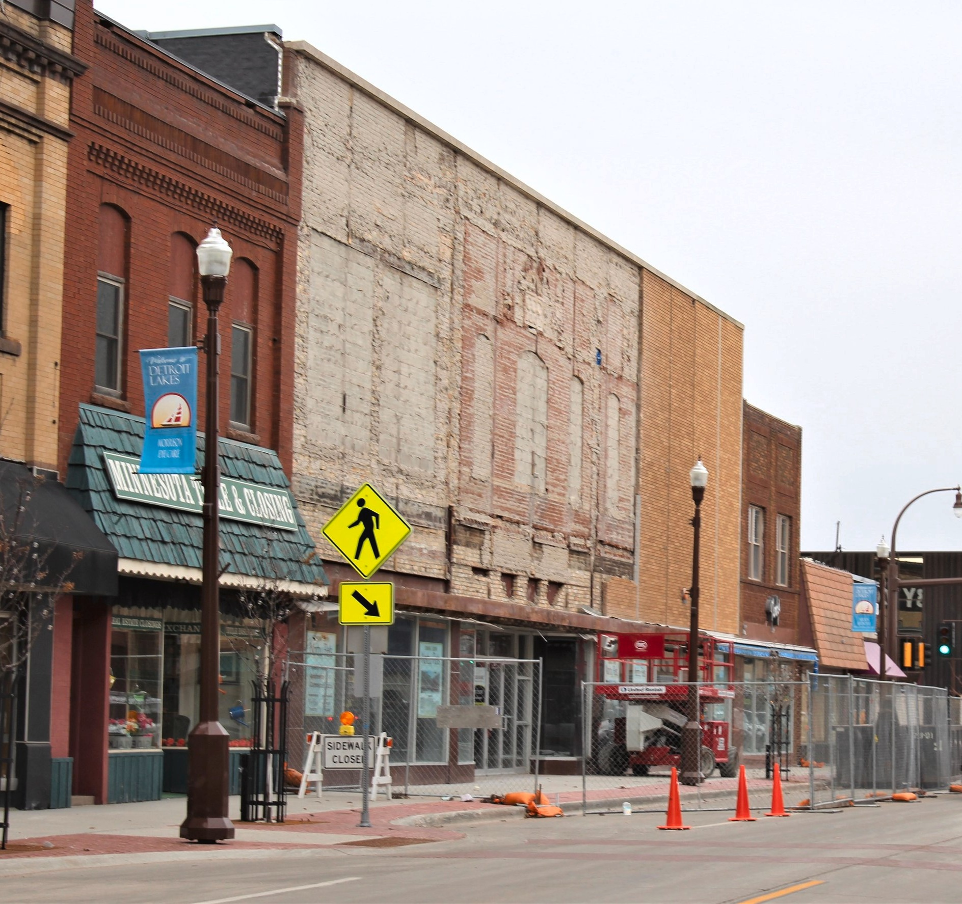As of Thursday, April 11, about two-thirds of the brick facade that had defined the look of Norby's Department Store since 1959 had been removed. Now under new ownership, the building is being renovated and returned to its original look of more than 100 years ago. It will have commercial space on the main level and apartments upstairs, and will go by the name of Norby Flats. (Marie Johnson / Tribune)