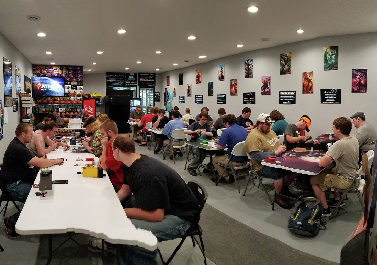 "A group plays Magic the Gathering at Ultima Gaming. ""It's pulling in really big numbers for a tiny town,"" Robbie Olson said of the store's following. (Submitted)"