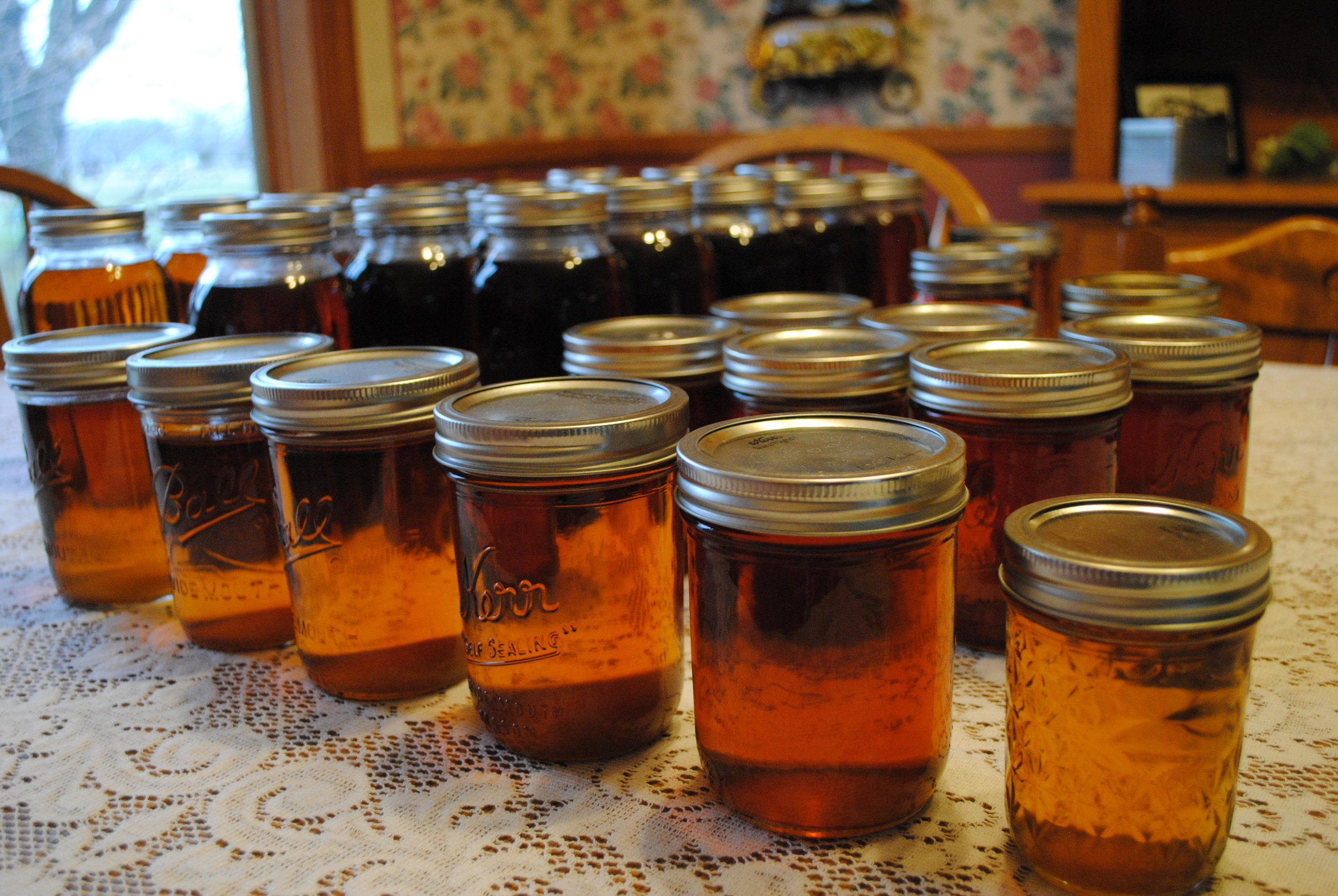Jars of new maple syrup produced by Susan and Leslie Bergquist thanks to maple trees in their yard and those of their neighbors in Granite Falls. Tom Cherveny / Forum News Service
