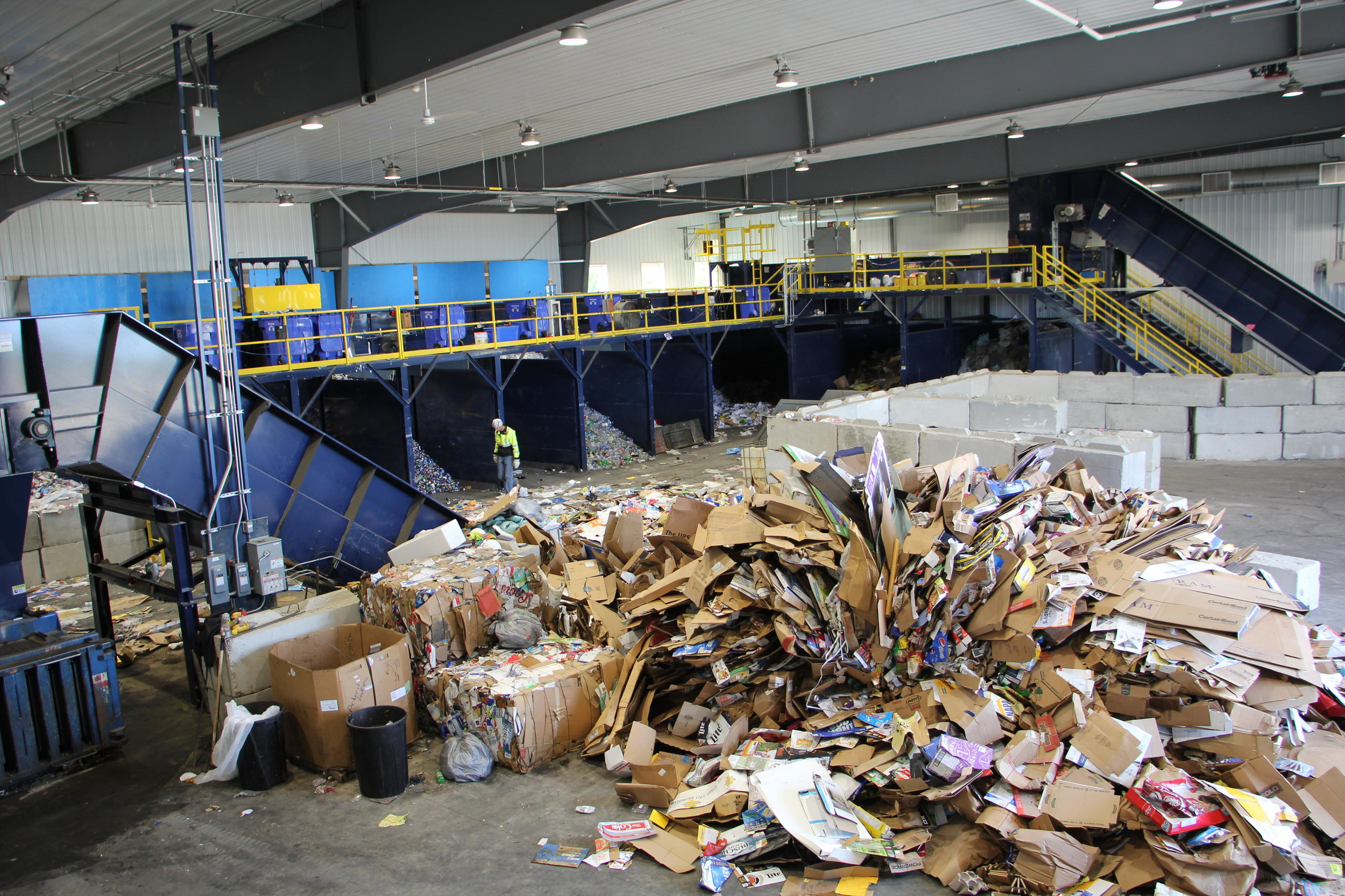 The Becker County recycling center will soon be streamlined with new equipment, thanks to a $200,000 purchase from Polk County. Much of the work now is done by hand. File photo
