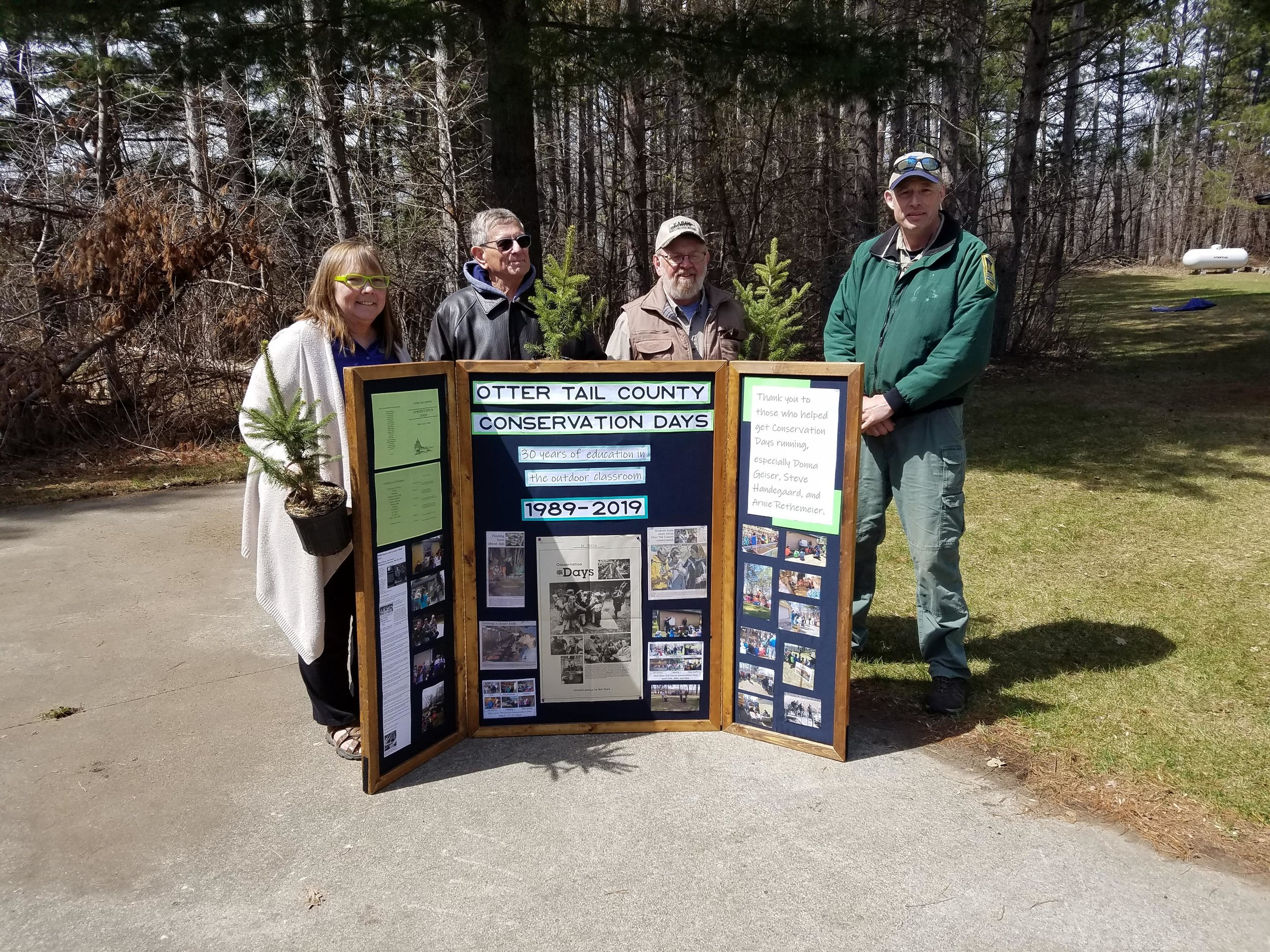 Left to right: Donna Geiser (Extension), Arnie Rethemeier (SWCD), Steve Handegaard (DNR), and Mike Nelson (DNR, helped start the tradition of Conservation Days in 1989 and were honored at this year's 30th Anniversary. Photo courtesy of East Otter Tail Soil and Water