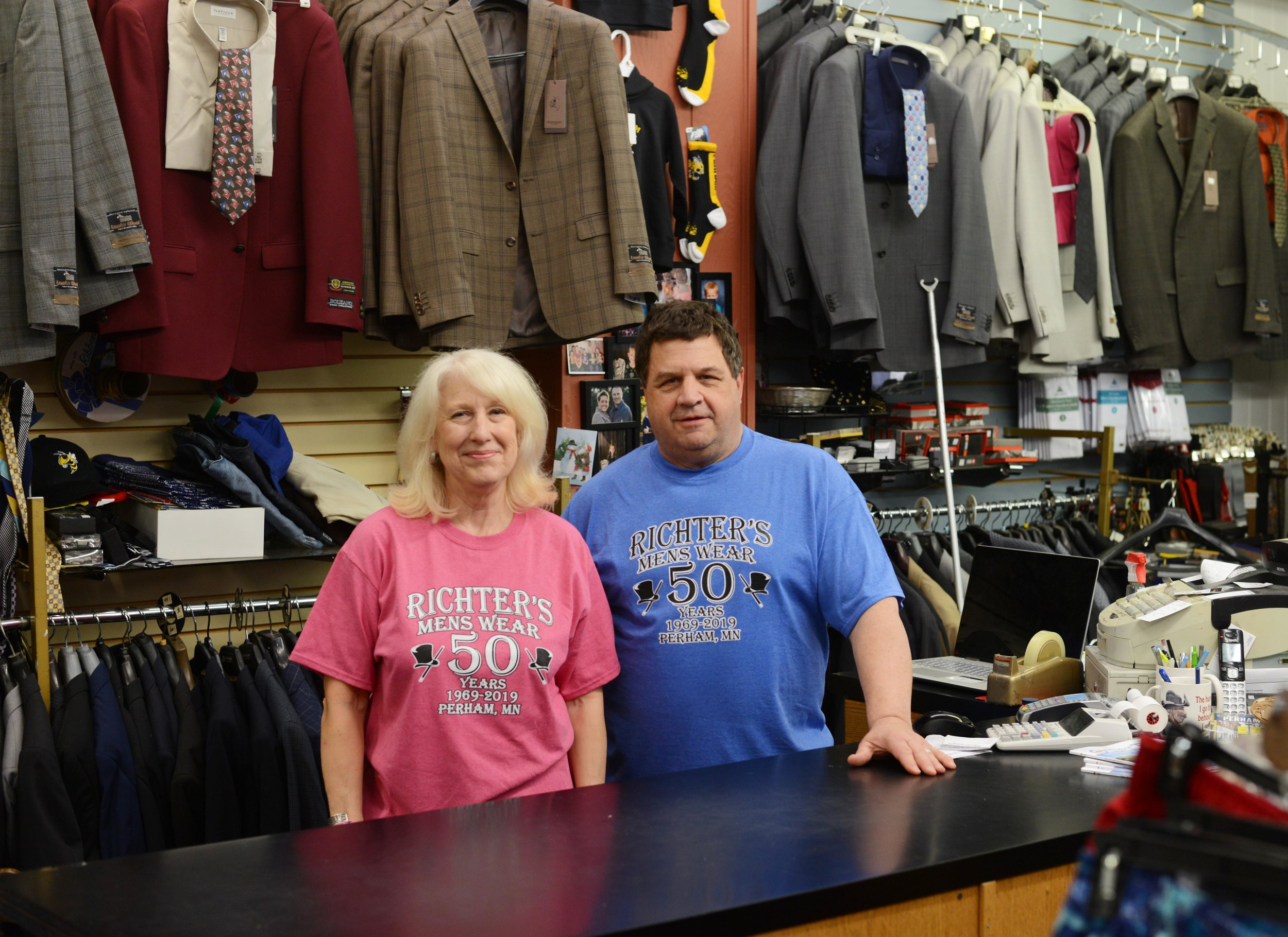 Connie and Steve Richter pose for a portrait in Richter's Men's Wear on May 28. Steve and Connie took over the store in 1983 from Steve's parents Gardy and Hilde Richter. (Carter Jones/ FOCUS)
