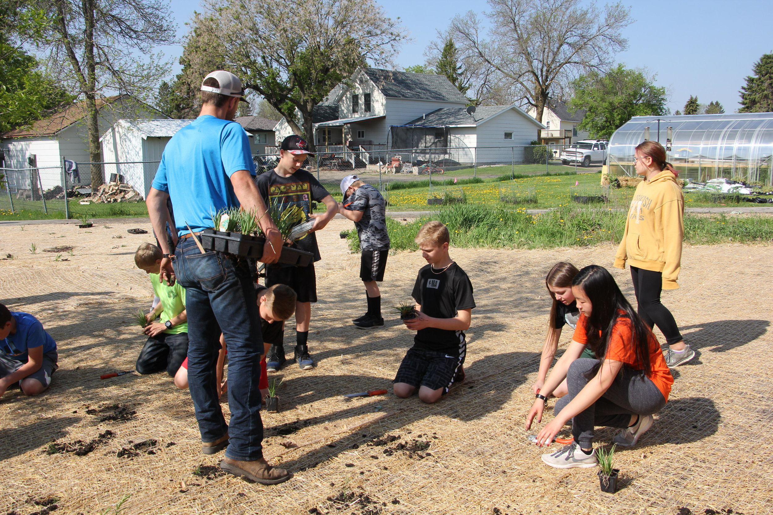 Logan Riedel of the Becker SWCD brings in some new seedlings for the sixth graders at LP-A Elementary School to start planting this past Wednesday morning. (Vicki Gerdes / Tribune)
