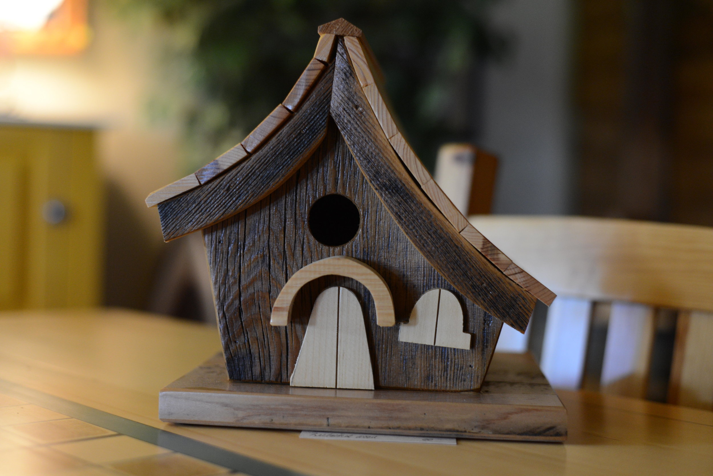 This custom birdhouse made from reclaimed wood will be given away as a door prize as part of the Art of the Lakes studio tour at Pine Mill Farm on Saturday afternoon. (Carter Jones/ FOCUS)