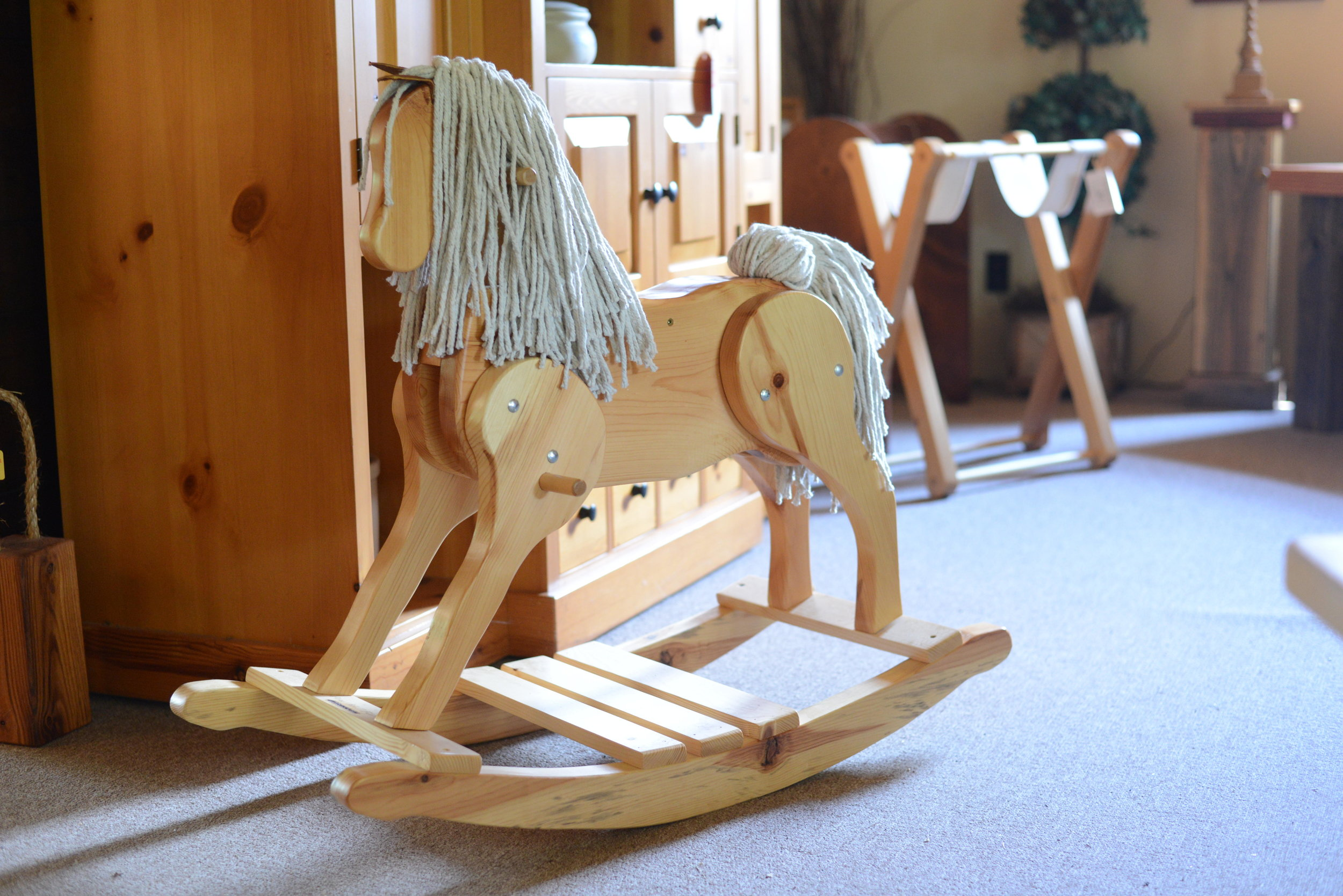 Roger and Shari Krause started Pine Mill Farm producing this rocking horse for wholesale catalogs in 1989. (Carter Jones/ FOCUS)