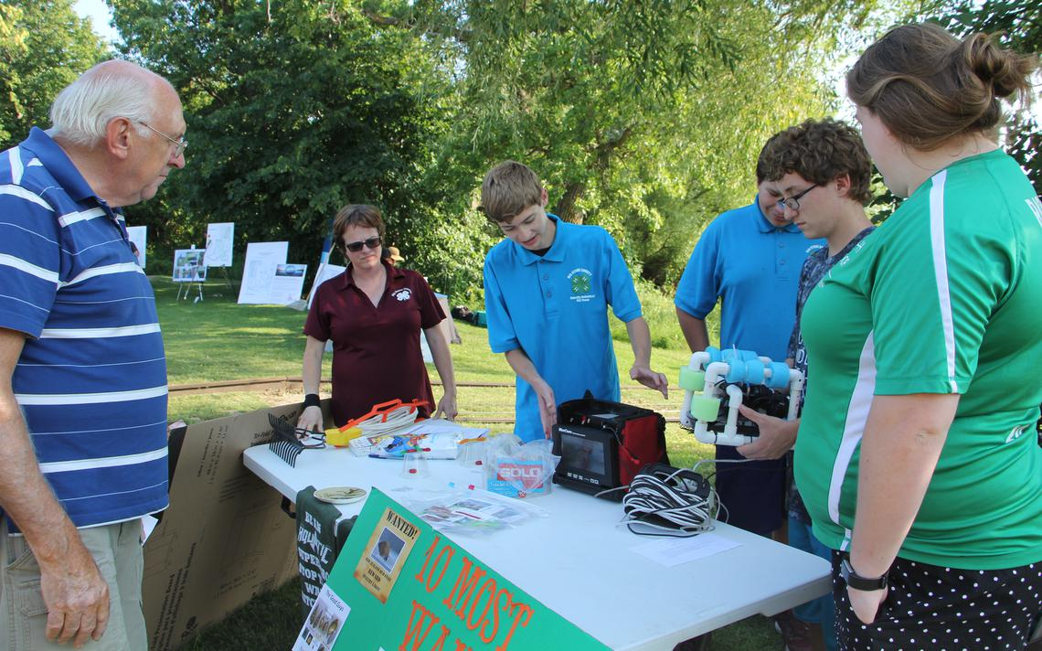 Members of the Big Stone County 4-H Aquatic Robotics team explained to a 2018 Aqua Chautauqua visitor how their underwater robot, the SeaPerch, operates underwater to detect aquatic invasive species and other bits of water quality information. The team will be returning for the 2019 Aqua Chatauqua this Thursday, Aug. 15. (Vicki Gerdes / Tribune)