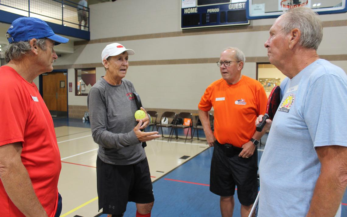 Helle Sparre, second from left, shares a few of her pickleball insights with Detroit Lakes pickleball players Mitch Winner, left, Jerry Enget and Lee Swanson at the courts inside the Detroit Lakes Community Center Monday, Aug. 12. Sparre is a former tennis star turned pickleball pro who travels across the country to advocate for the sport and teach others how to play. (Marie Johnson / Tribune)(Marie Johnson / Tribune)