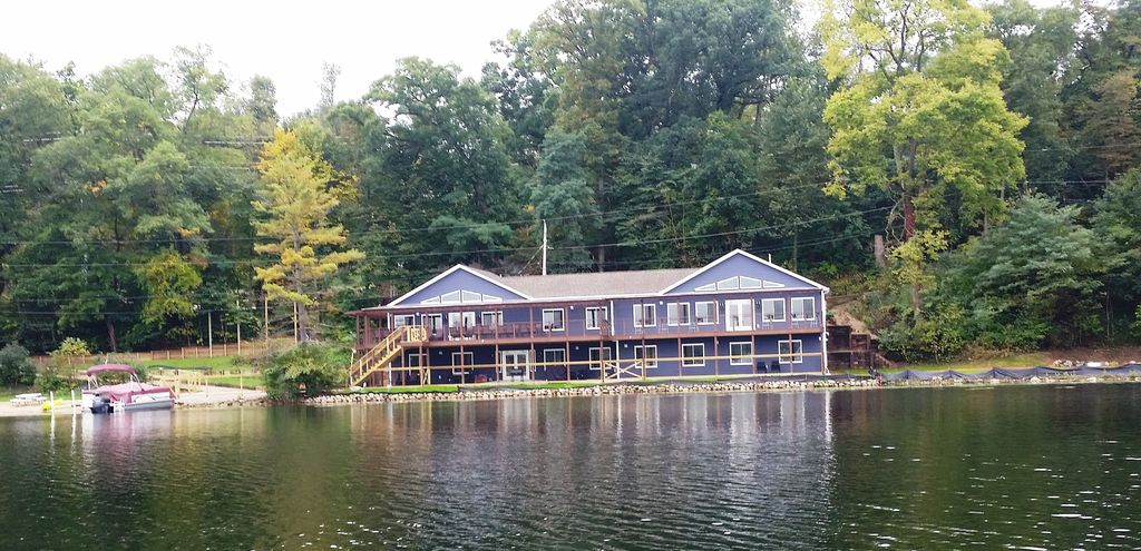 The house sits on 340 ft of lake frontage w/ beach & 2 grassy, level play areas.