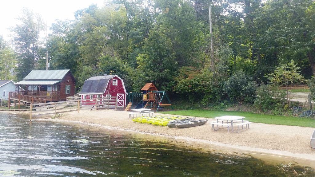 Sandy gentle-slope private beach is 80 ft long has tables; kayak racks coming!