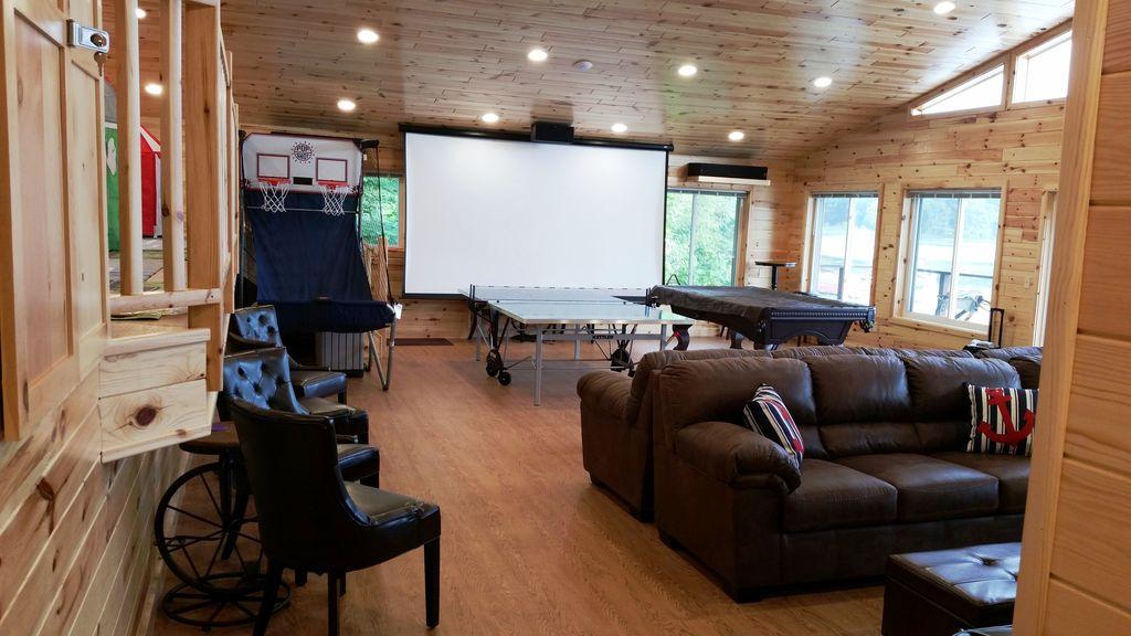 12-foot HD projector TV screen, Klipsch Surround Sound...great audio-video!
